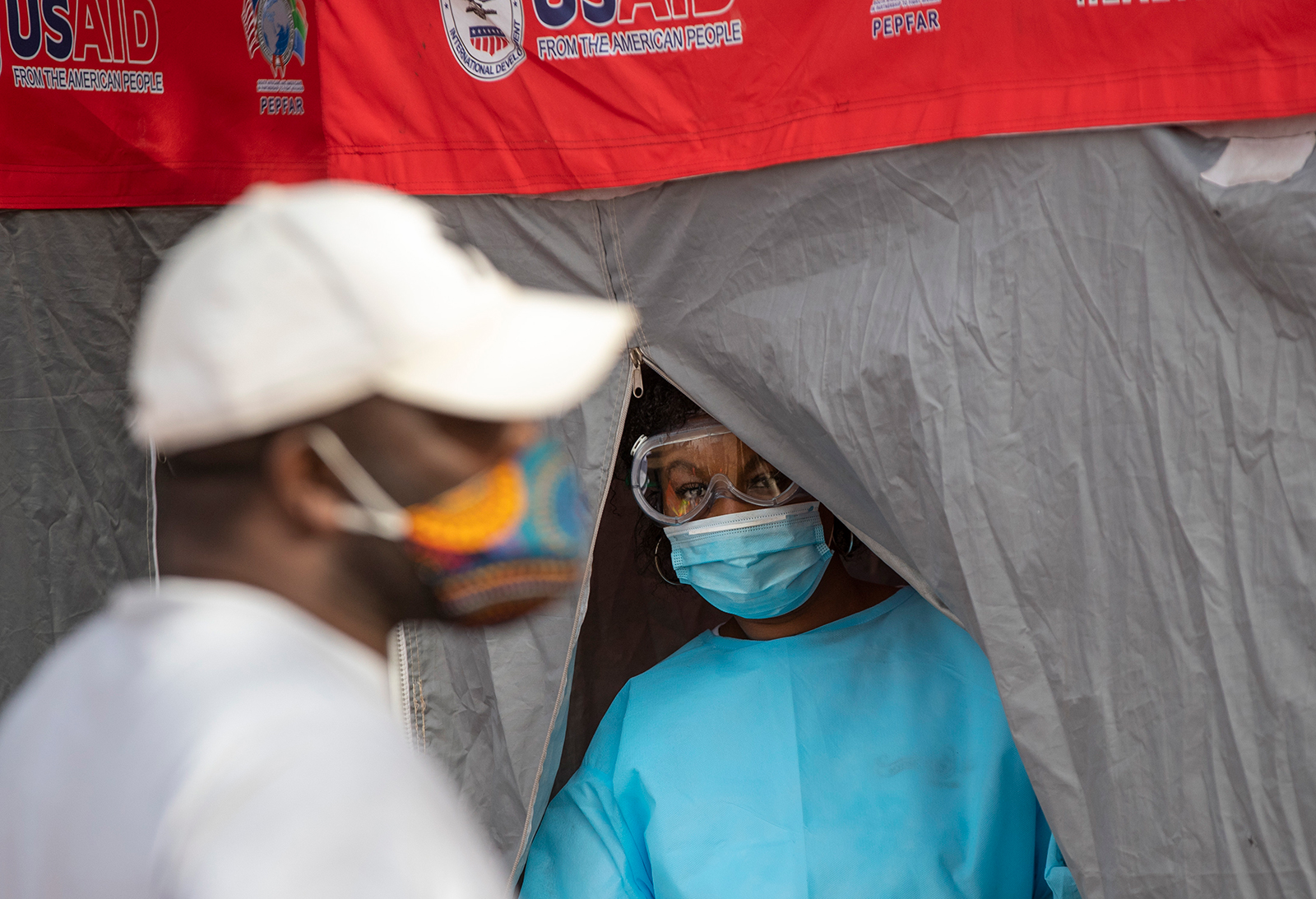 A heath worker looks on during the screening and testing campaign aimed to combat the spread of COVID-19 at Tembisa township in Johannesburg, South Africa, on Tuesday, May 19.