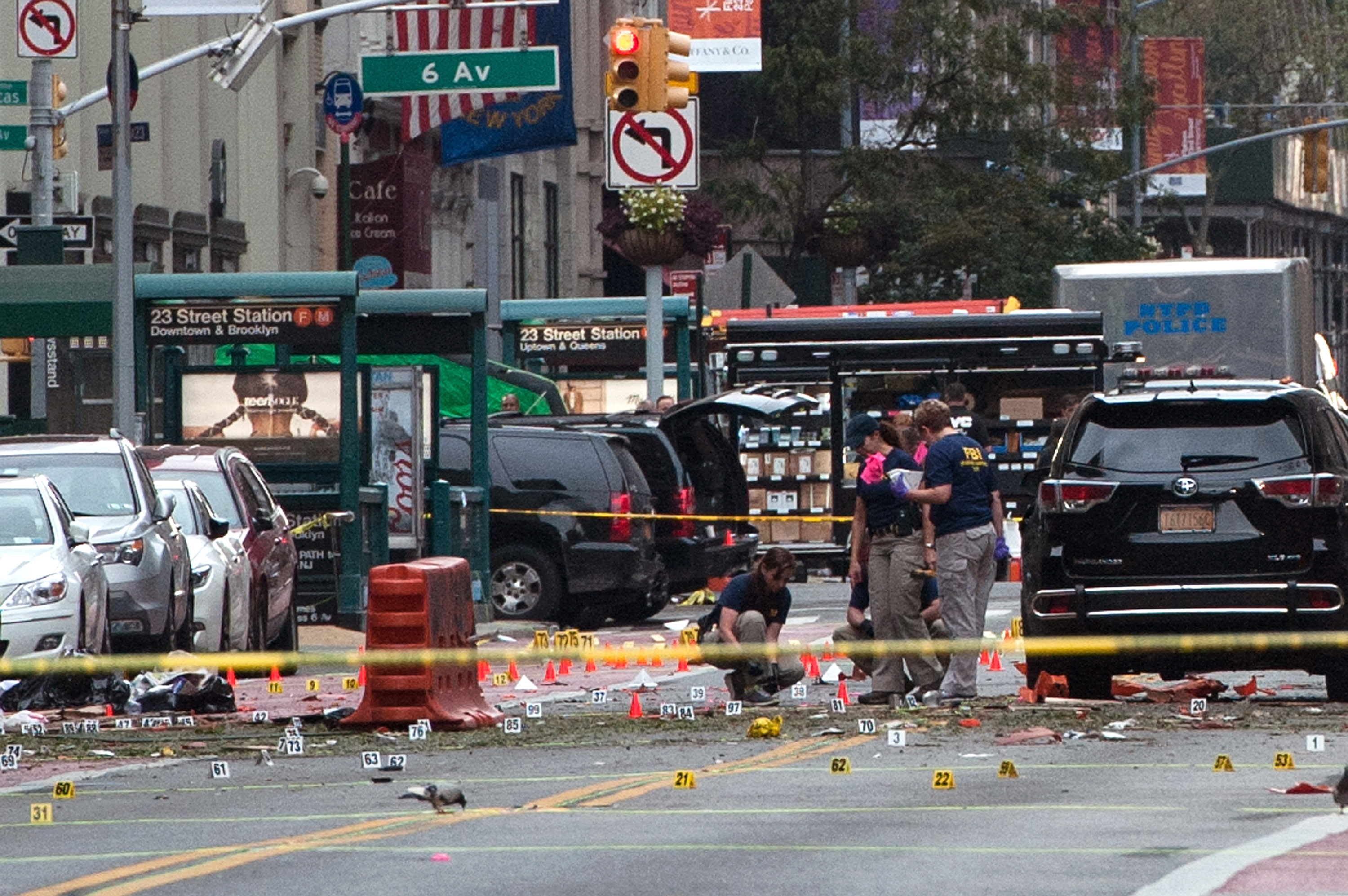 FBI agents review the crime scene of remnants of bomb debris on 23rd St. in Manhattan's Chelsea neighborhood on Sept. 18, 2016 in New York City.