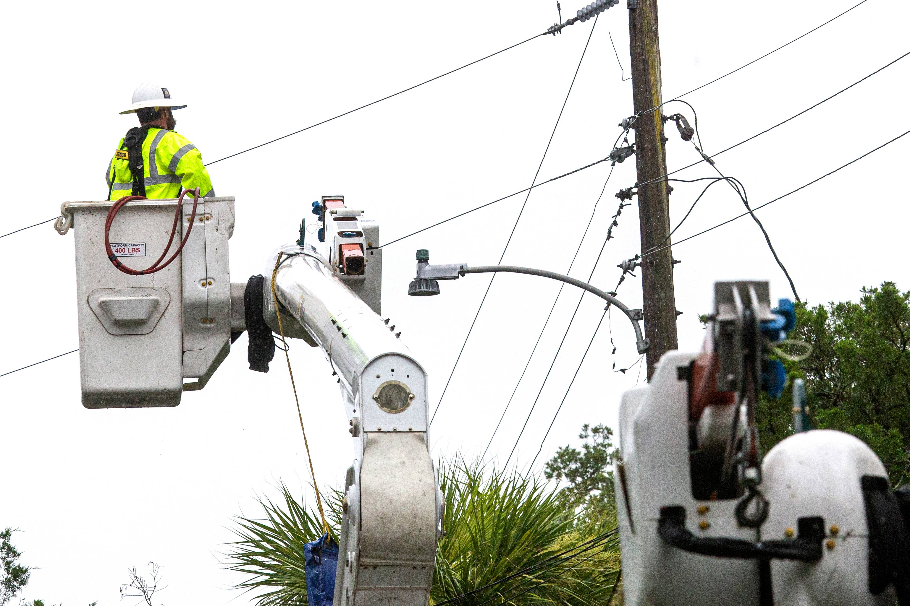 Power crews work to restore power after Tropical Storm Elsa made landfall nearby on July 7 in Cedar Key, Florida.