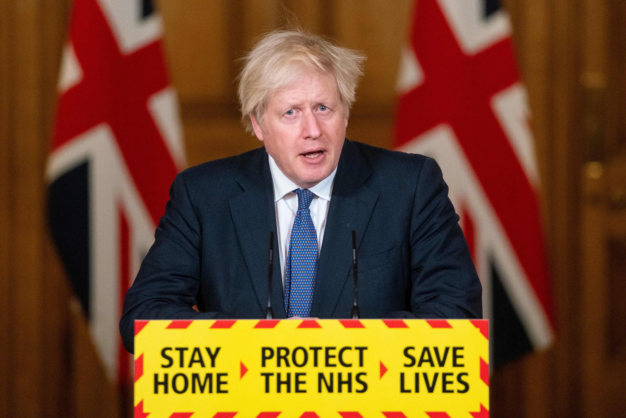 Britain's Prime Minister Boris Johnson speaks during a virtual press conference at 10 Downing Street in London on January 15.
