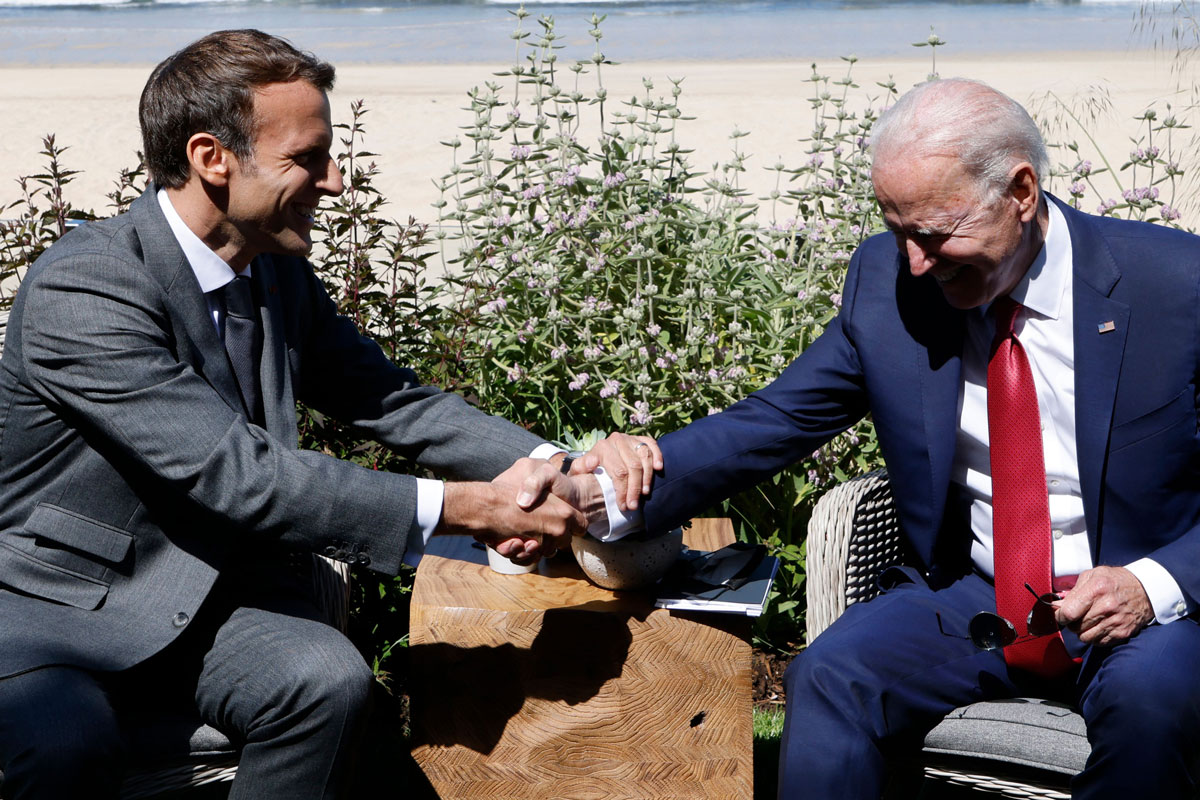 France's President Emmanuel Macron (L) greets US President Joe Biden before a bilateral meeting in Carbis bay, Cornwall on June 12.