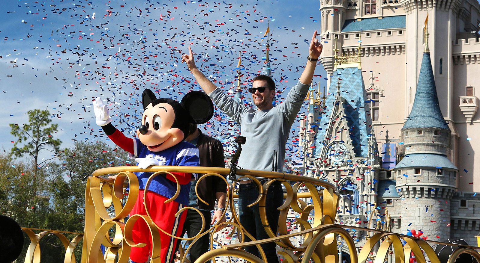Super Bowl LIII winning quarterback Tom Brady of the New England Patriots celebrates with Mickey Mouse in the Super Bowl victory parade in the Magic Kingdom at Walt Disney World, in Lake Buena Vista, Florida, on February 4, 2019.