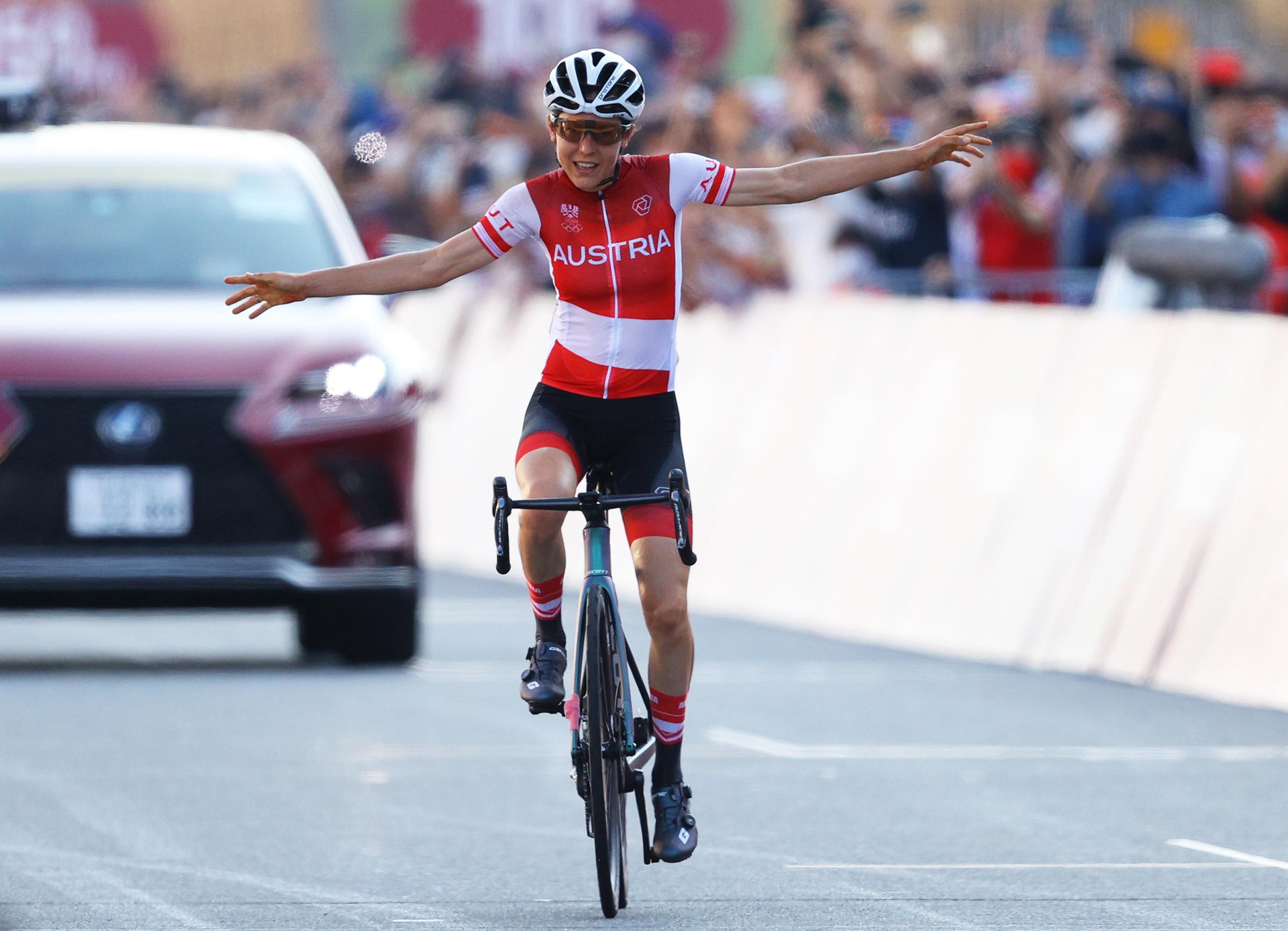 Austria's Anna Kiesenhofer celebrates winning the women's road race on July 25.