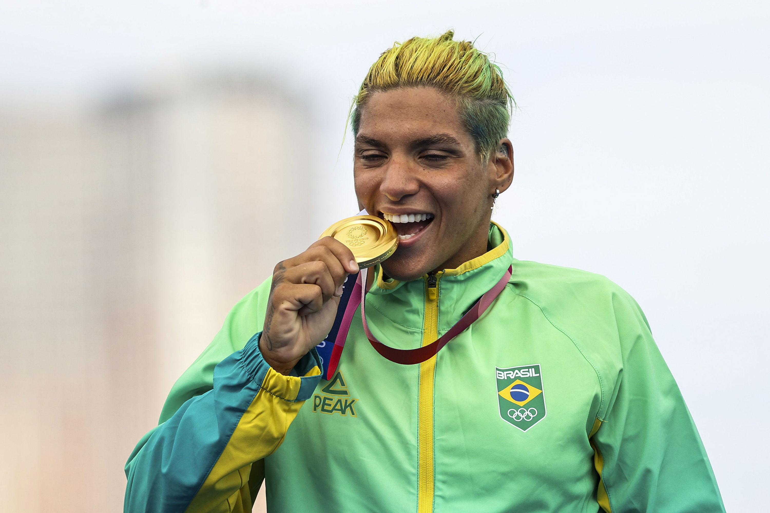 Ana Marcela Cunha of Brazil celebrates her gold medal win in the 10 kilometer swimming event on August 4.