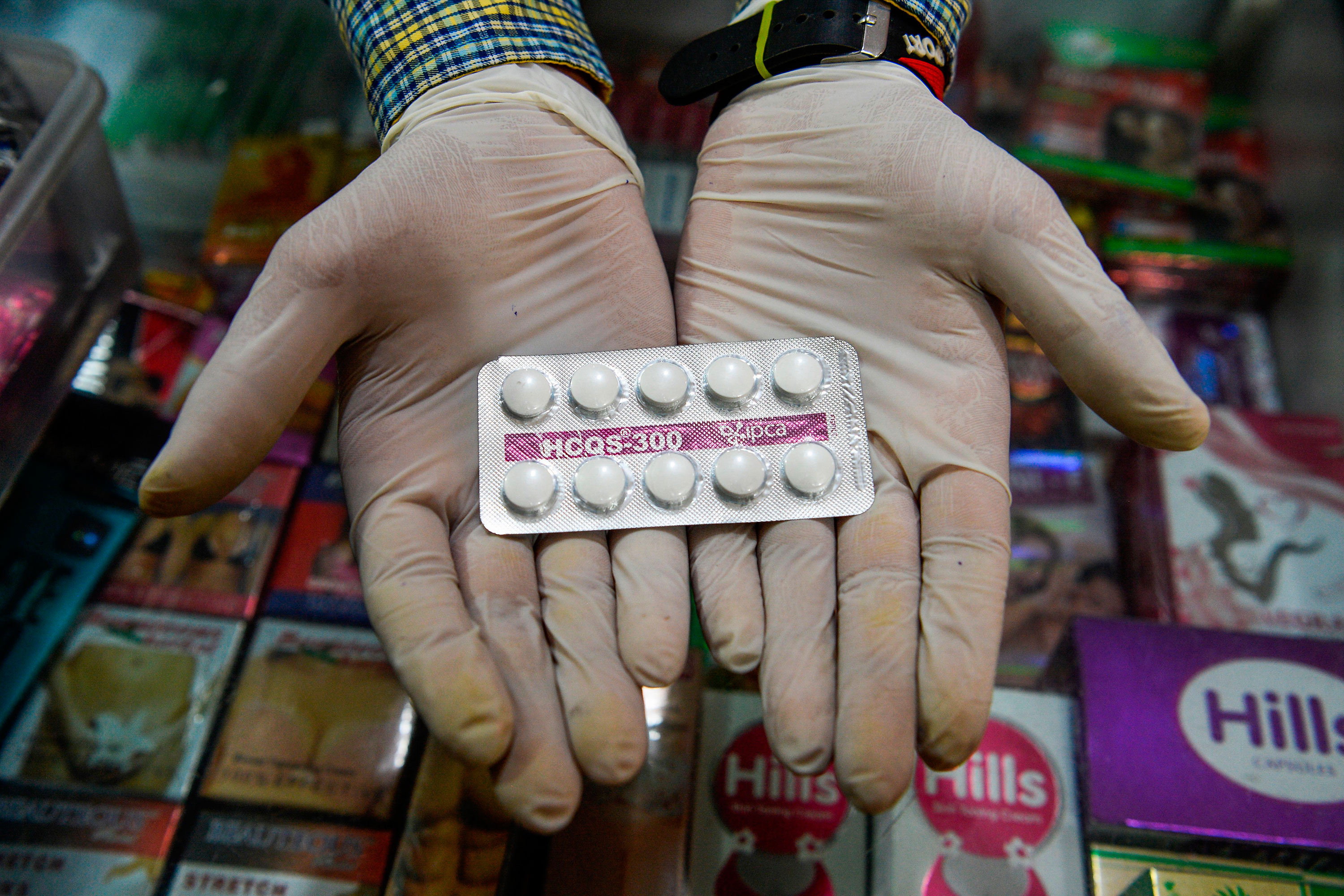 A vendor displays hydroxychloroquine (HCQ) tablets at a pharmacy in New Delhi, India.