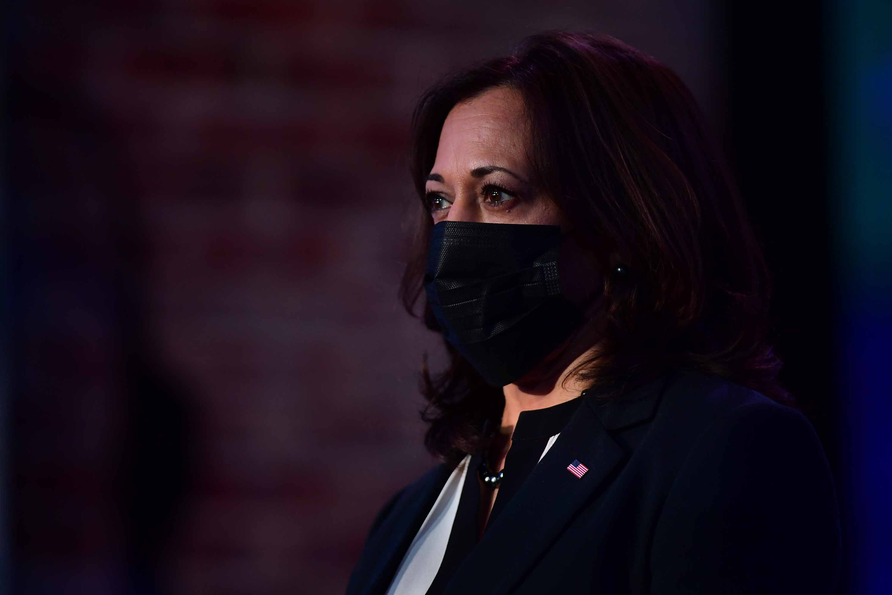 Vice President-elect Kamala Harris listens as President-elect Joe Biden delivers remarks at the Queen Theater in Wilmington, Delaware, on December 28.