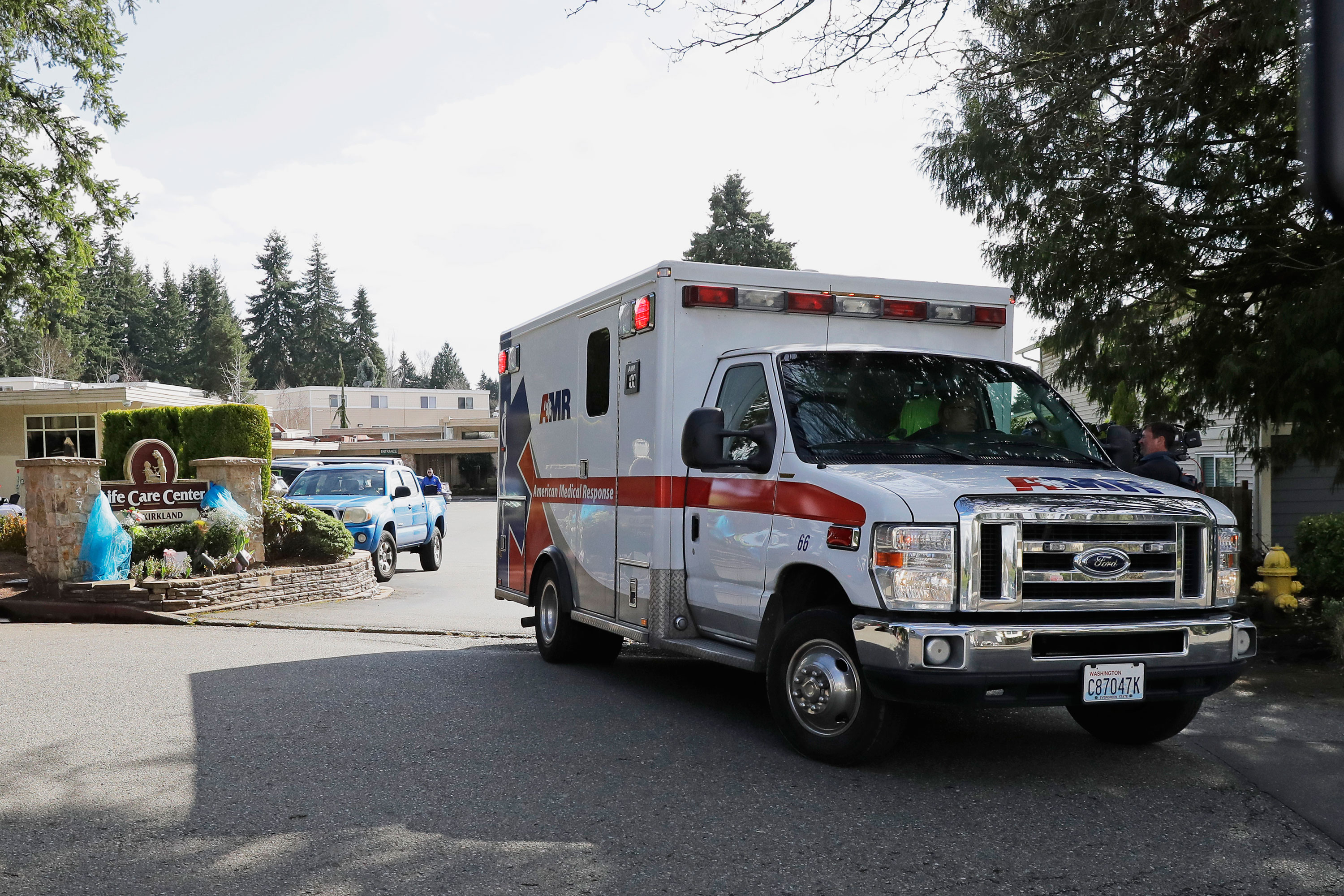 An ambulance leaves Life Care Center in Kirkland, Washington on March 12.
