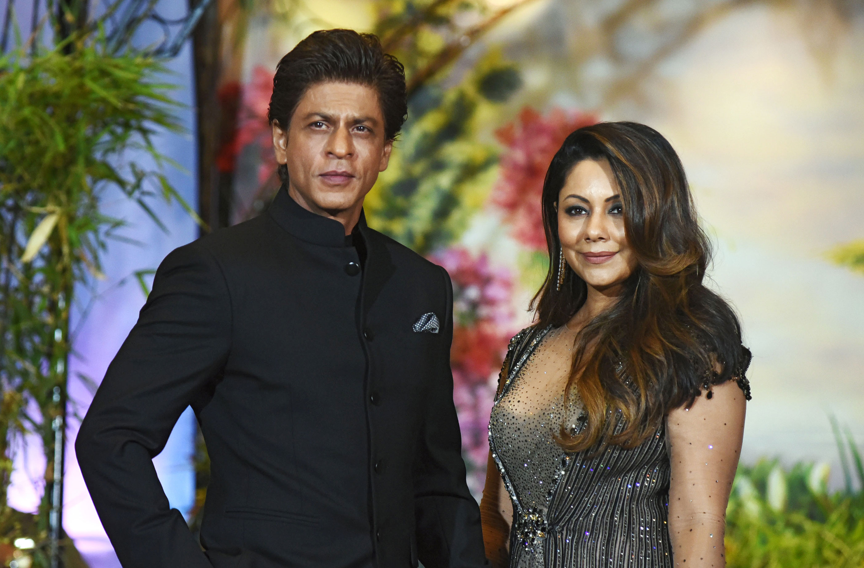 Actor Shah Rukh Khan and his with wife Gauri Khan attend a wedding reception in Mumbai on May 8, 2018.