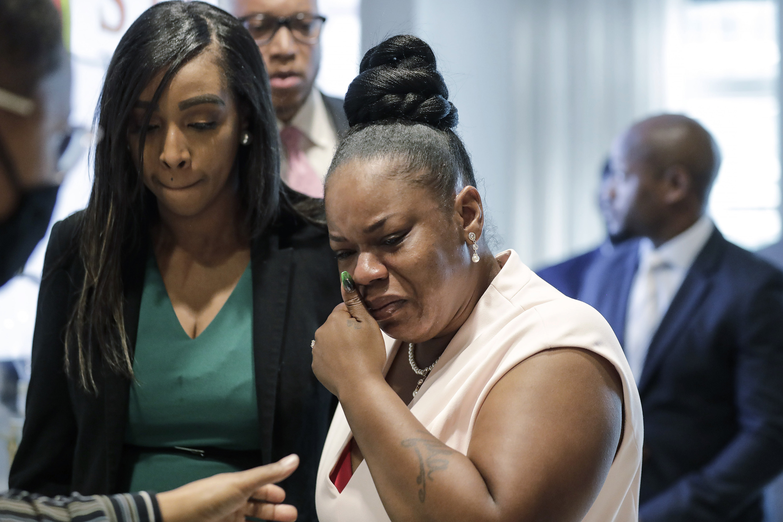 Tomika Miller, center, widow of Rayshard Brooks, cries as she leaves a news conference in Atlanta, Georgia, on Wednesday, June 17.