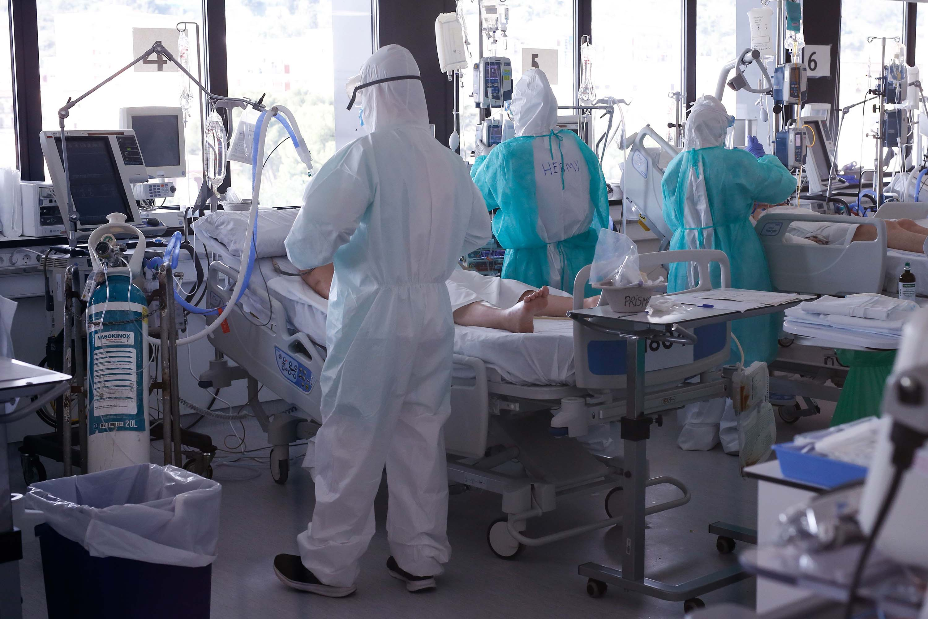 Healthcare workers tend coronavirus patients at in the intensive care unit at the Vall d'Hebron Hospital in Barcelona, Spain, on April 6.