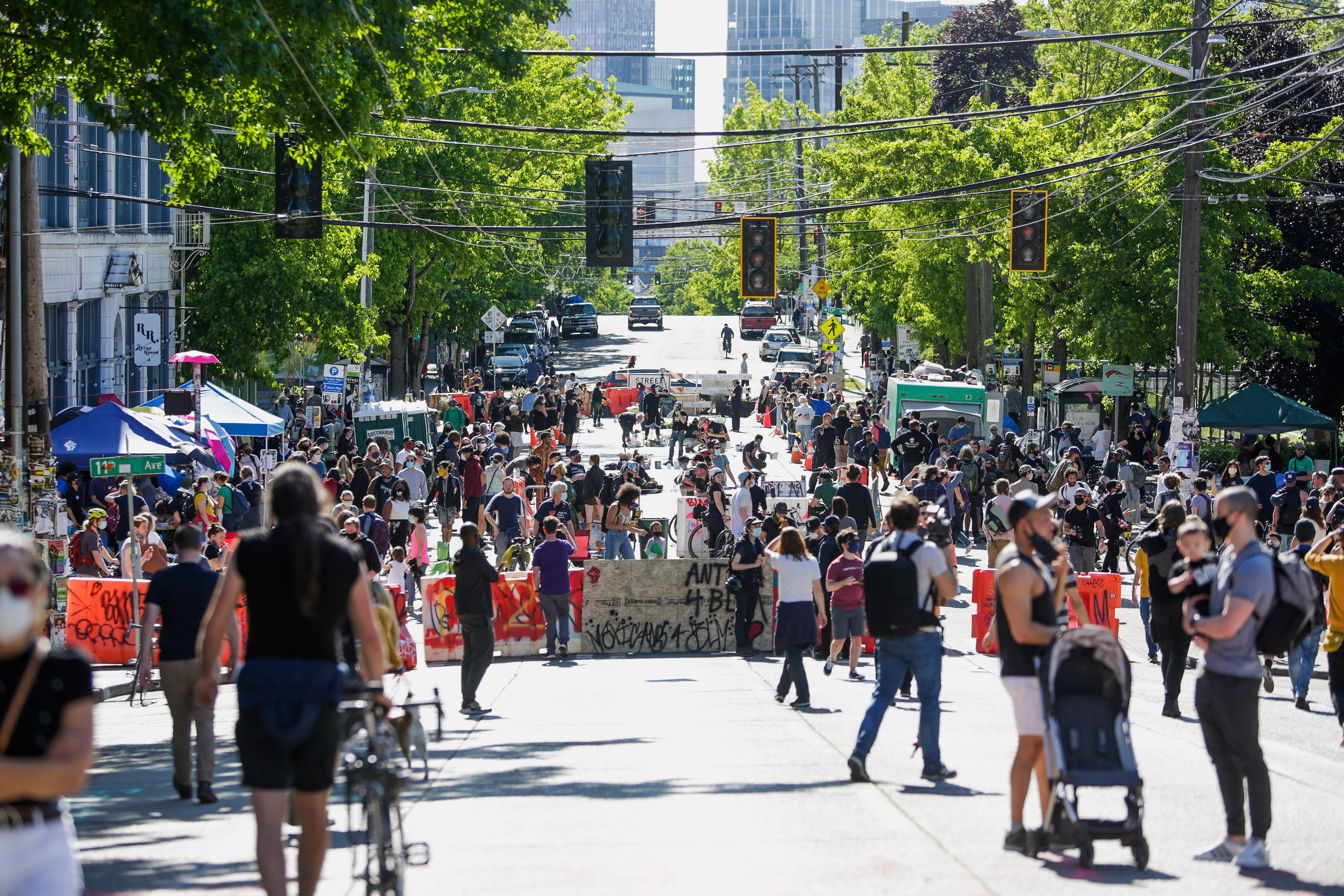 "People walk around the ""Capitol Hill Autonomous Zone,"" on June 11 in Seattle, Washington."