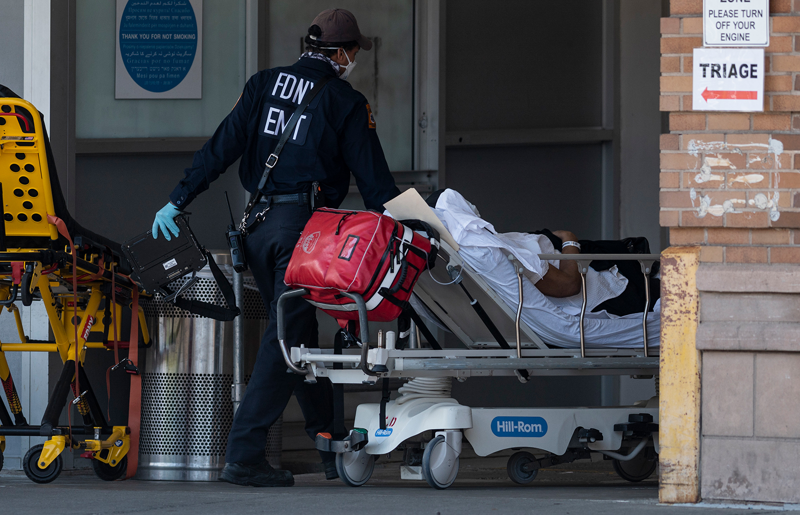 Medical workers transport a patient outside a special COVID-19 illness area at Maimonides Medical Center  in Brooklyn, New York on May 17.