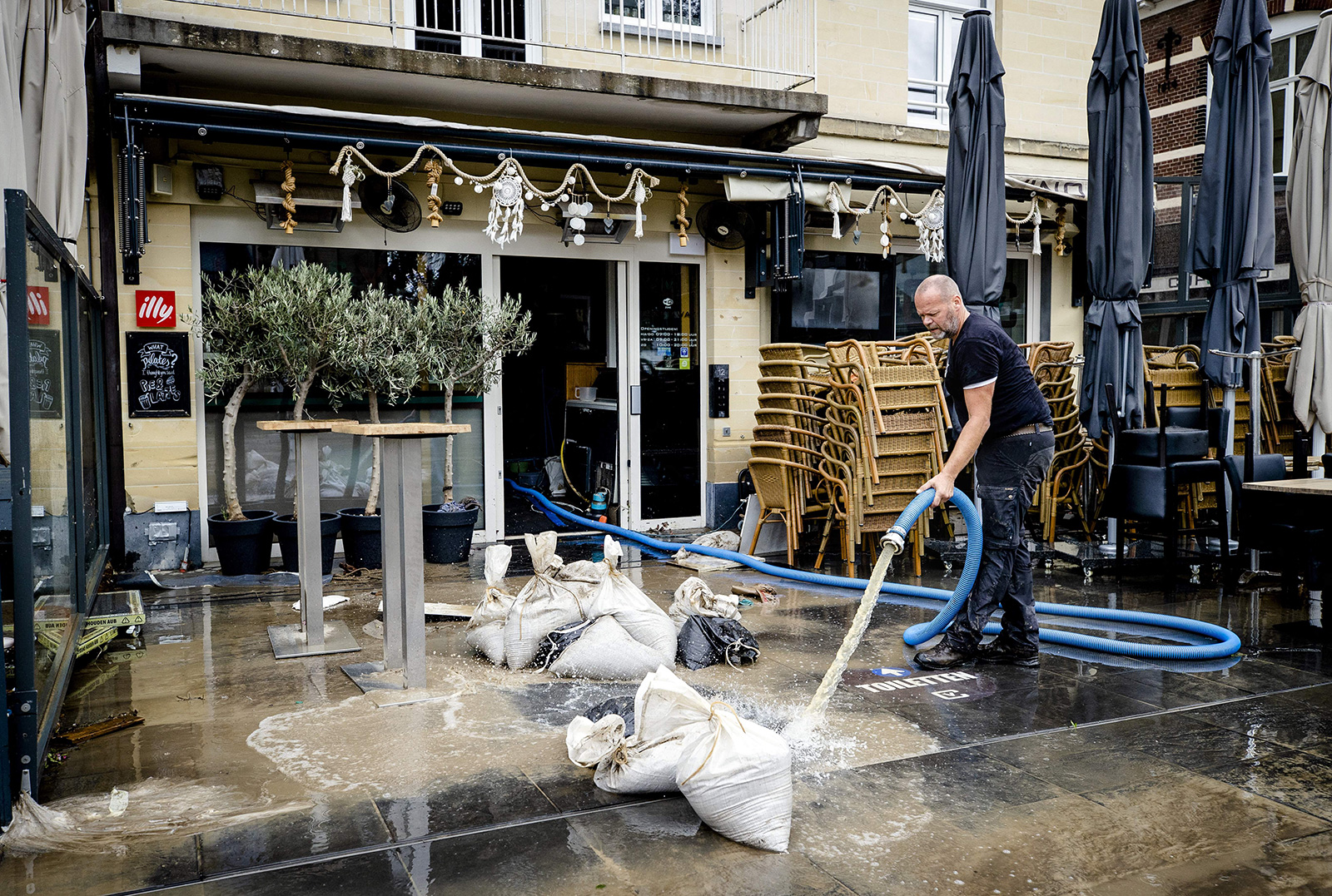 A business owner is pumping water out of his premises, following the damage inflicted by the flooding Geul river in Valkenburg on July 16.