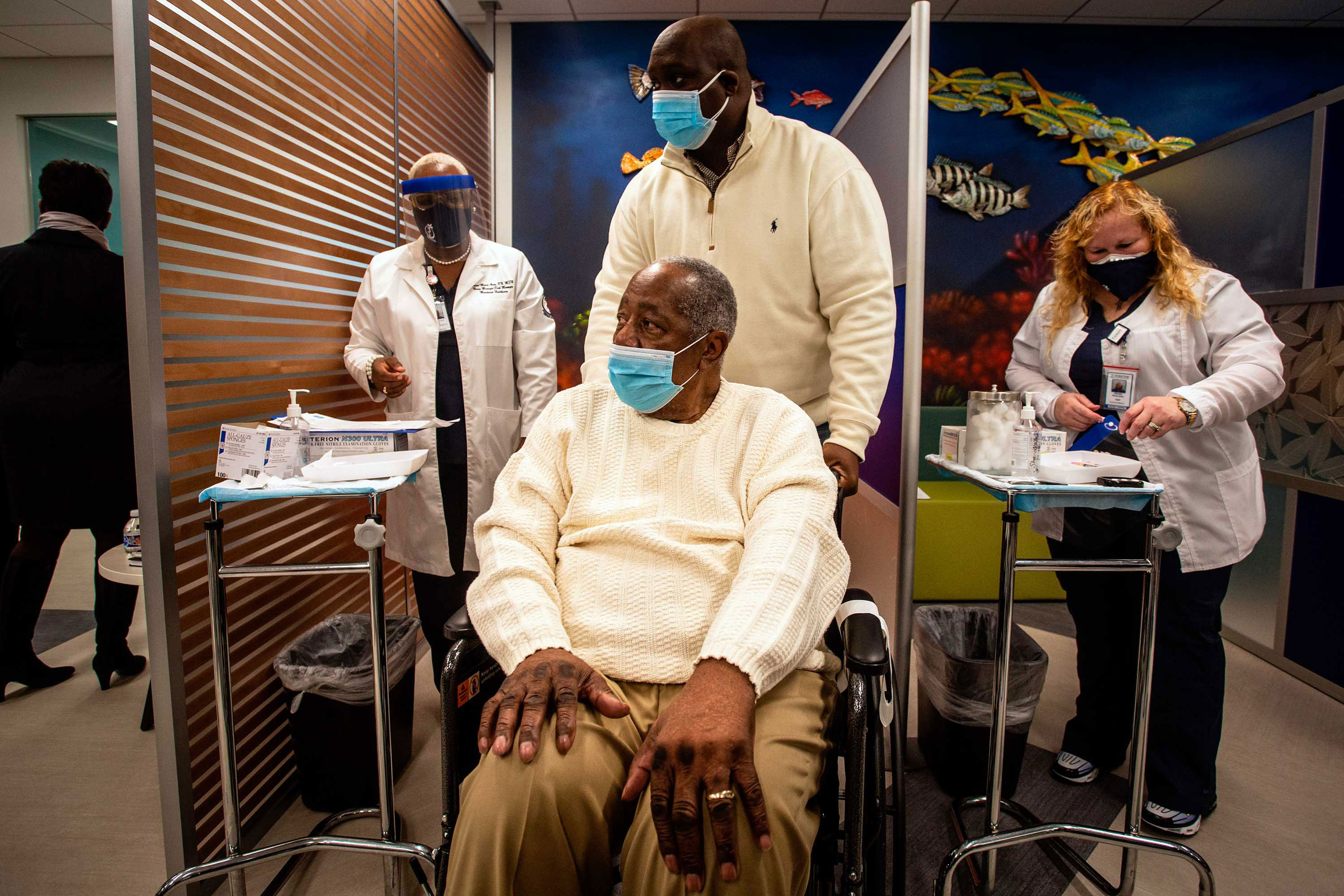 Baseball Hall of Famer Hank Aaron prepares to receive his Covid-19 vaccination on January 5 at Morehouse School of Medicine in Atlanta.