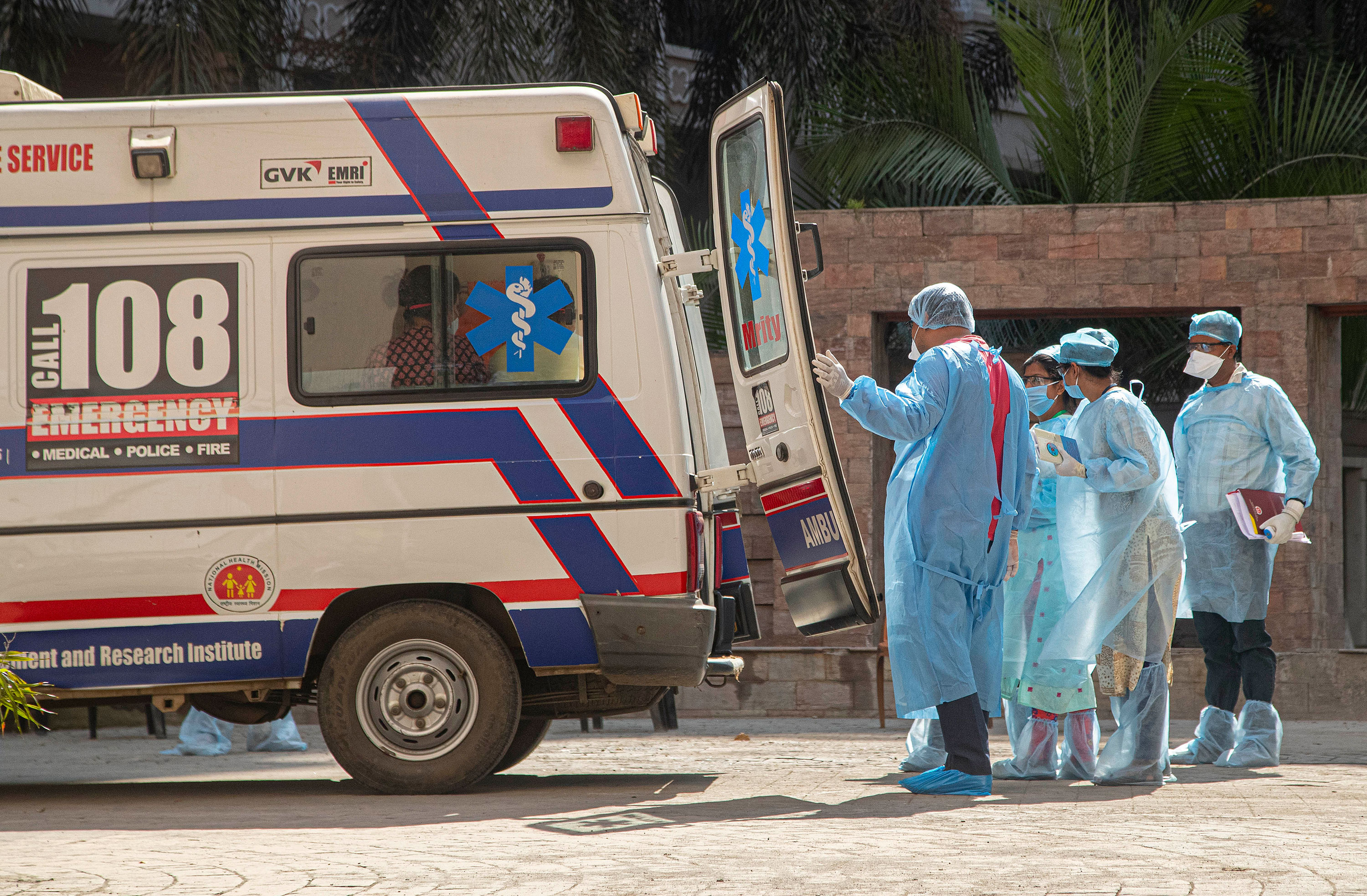 Health workers transport people from an apartment complex to a hospital for quarantine in Gauhati, India on April 4.