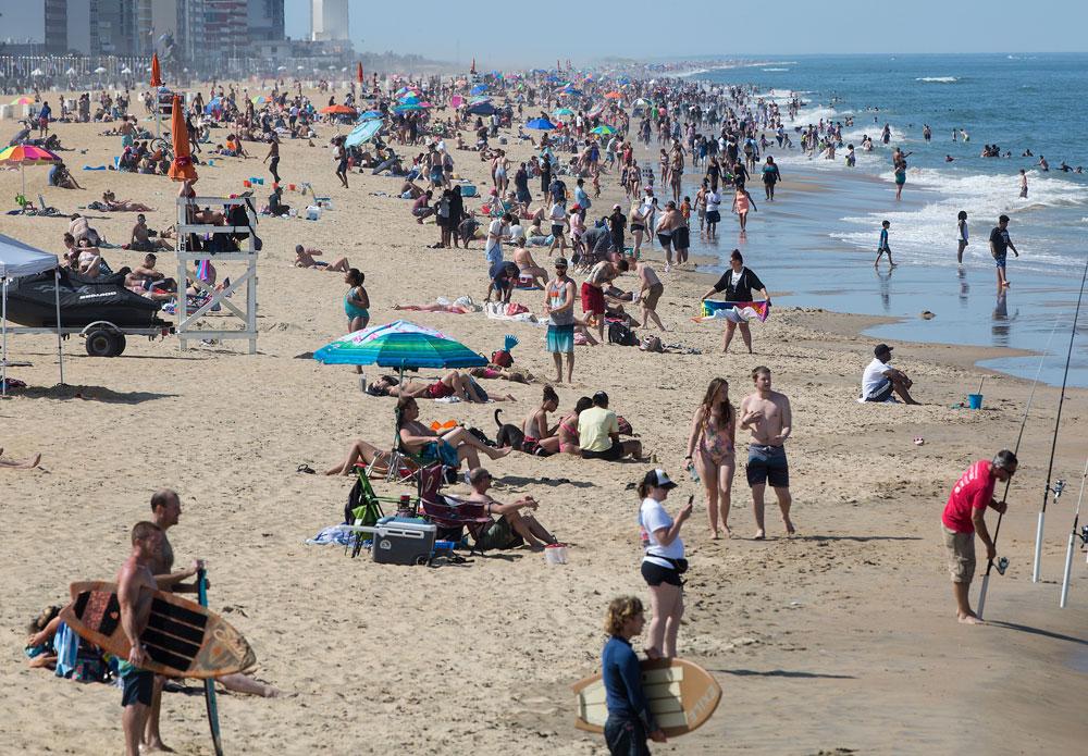 Beachgoers enjoy the warm weather in Virginia Beach on Saturday, May 16.