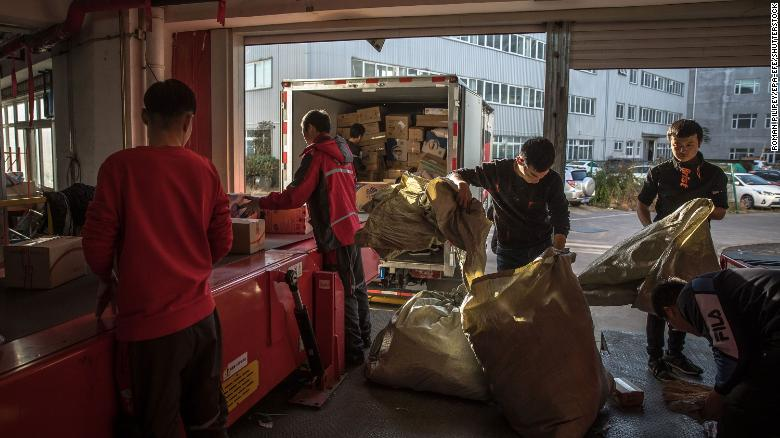 Workers sort packages at a delivery station for JD.com in Beijing in November 2019.