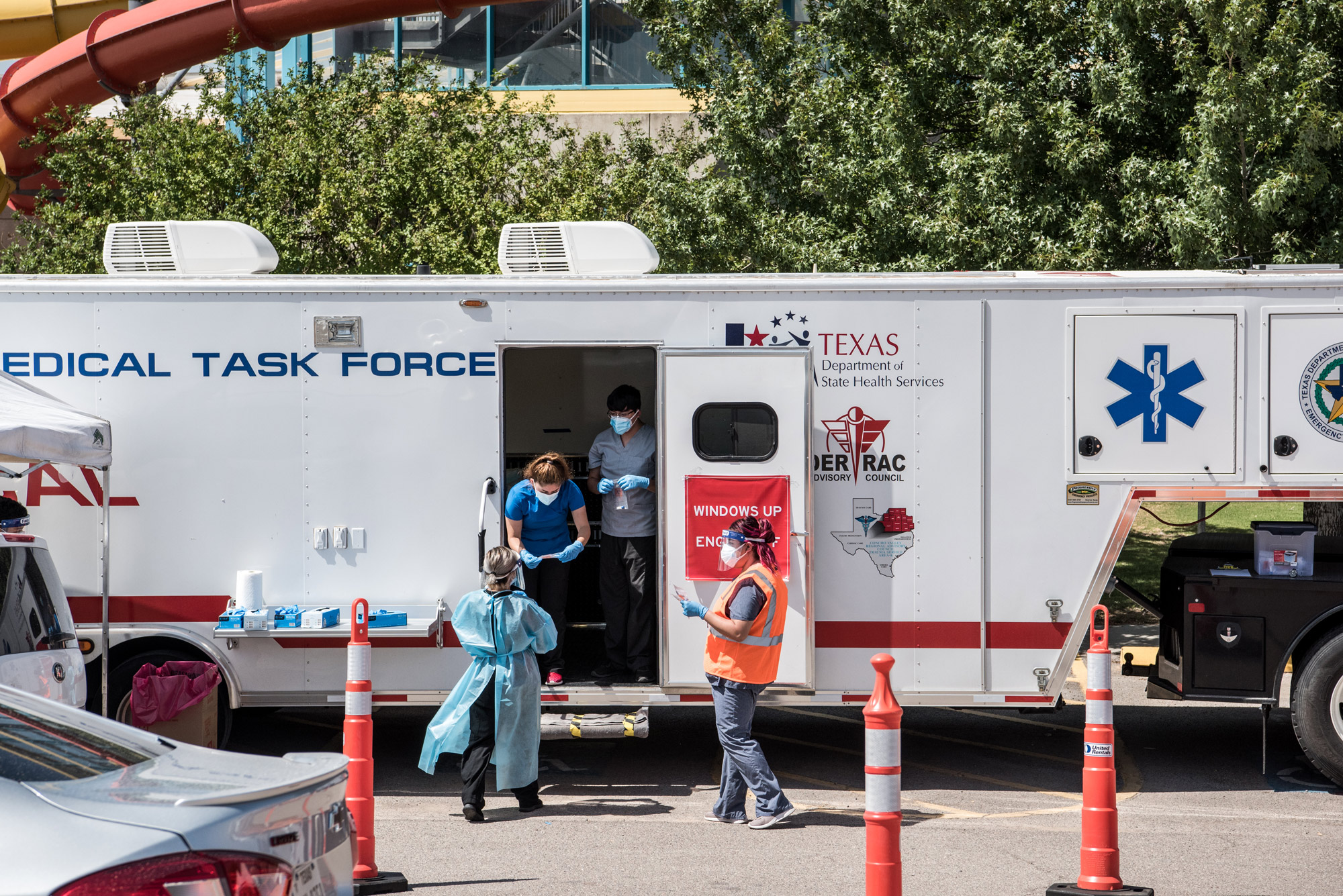 Nurses conduct coronavirus testing at a drive-thru site at SISD Student Activities Complex on July 21 in El Paso, Texas.