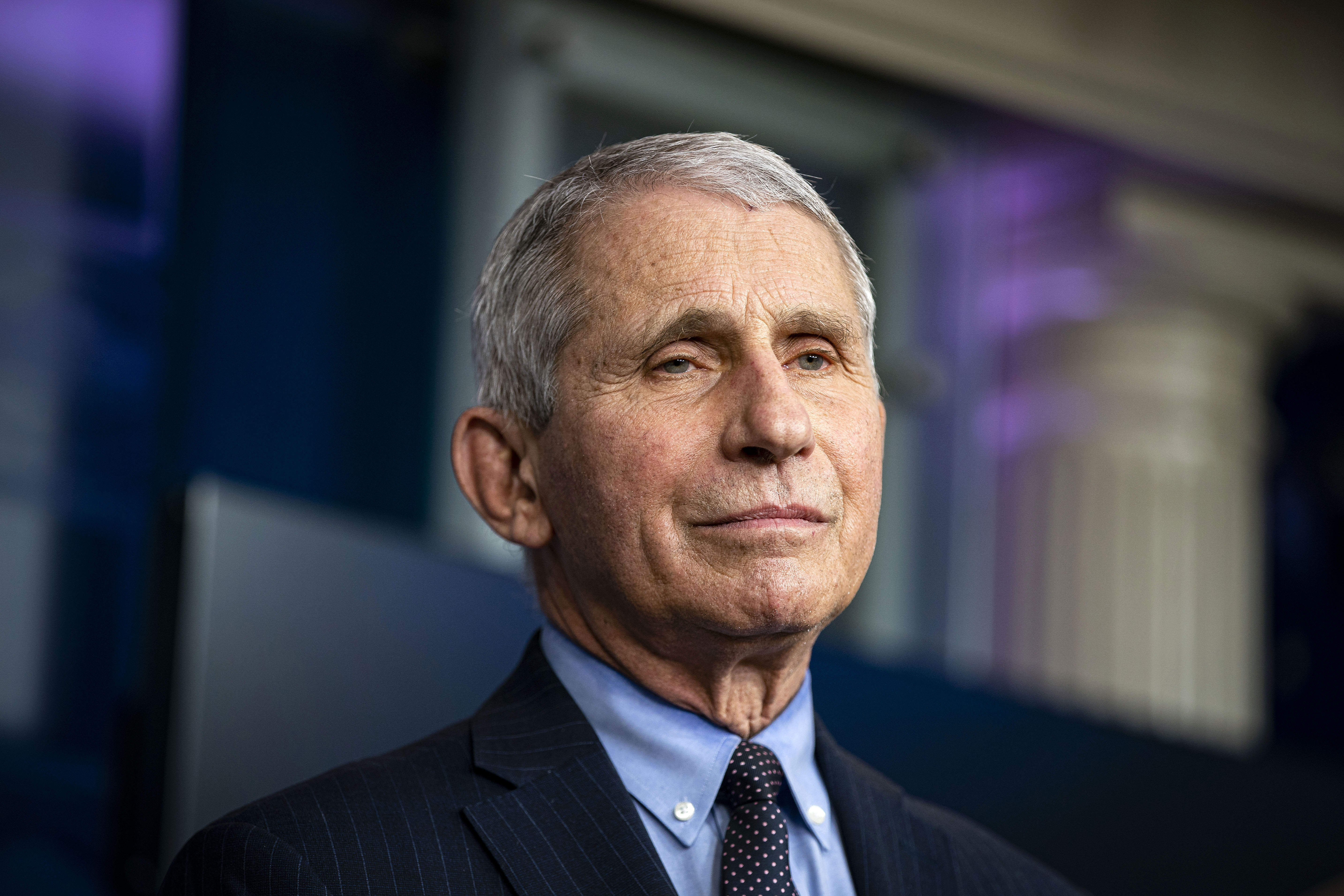 Dr. Anthony Fauci, director of the National Institute of Allergy and Infectious Diseases, listens during a news conference at the White House on January 21.
