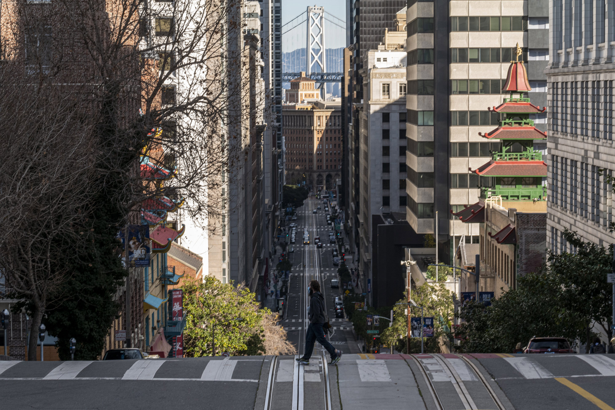A pedestrian crosses the street in San Francisco on December 29.