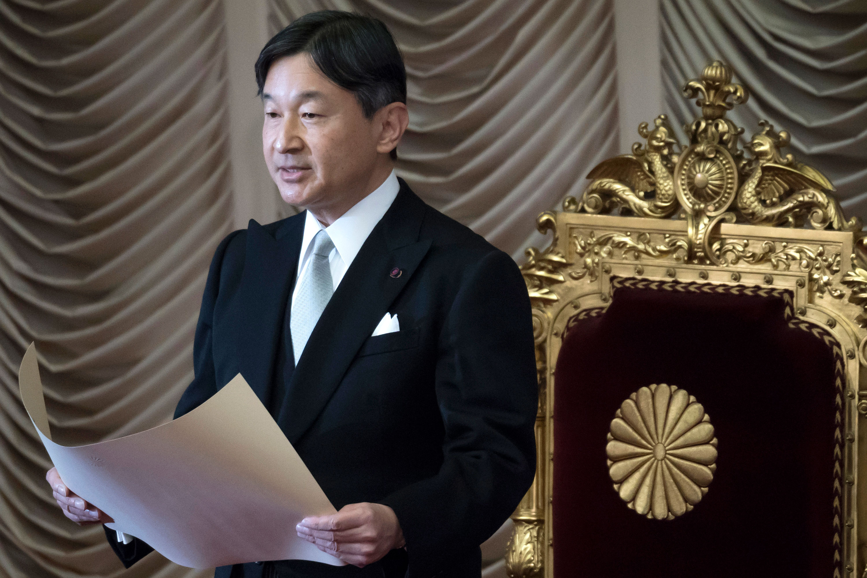 In this file photo, Japan's Emperor Naruhito gives an address at the opening of the 201st ordinary session of the Diet at the upper house of the parliament on January 20 in Tokyo.