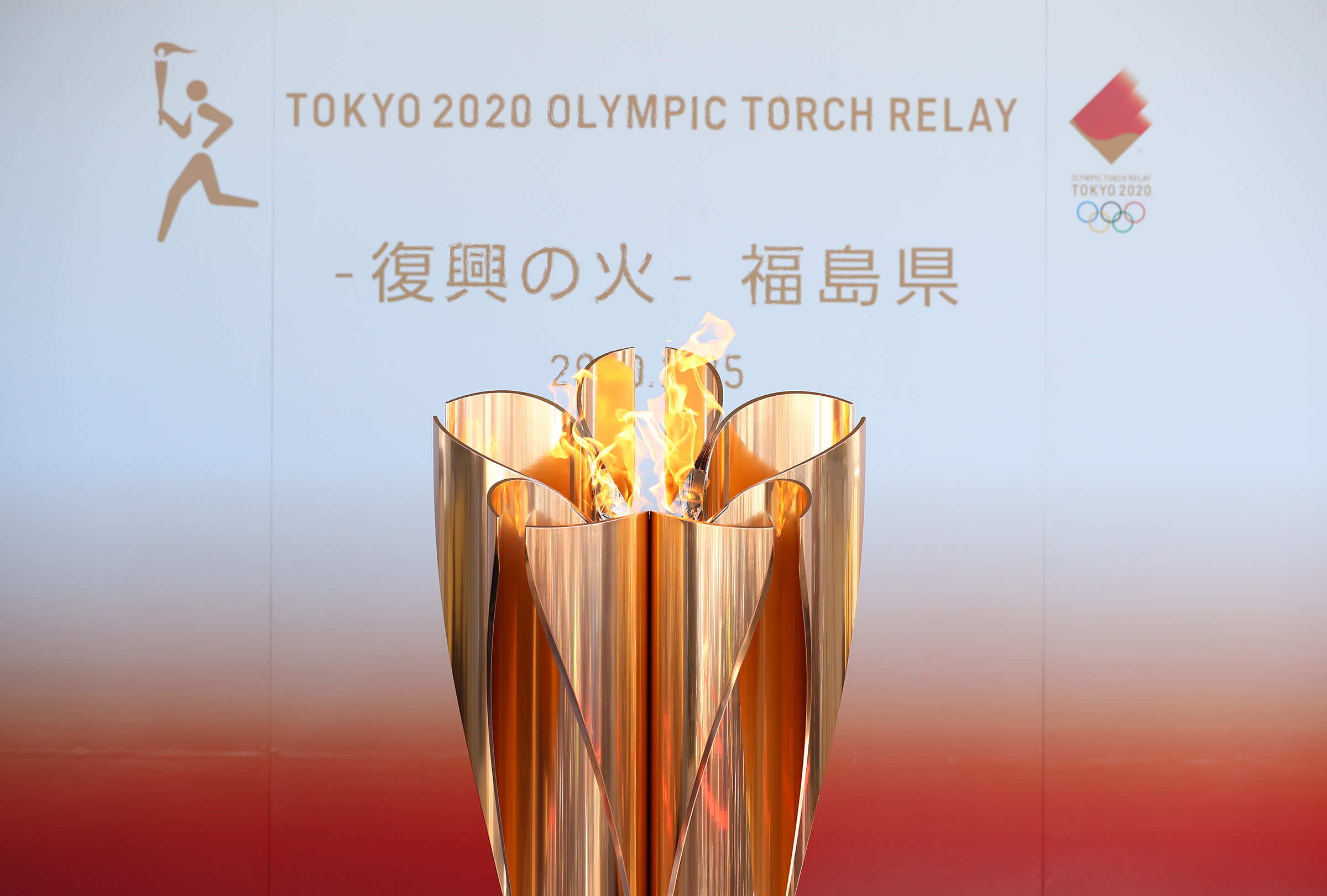 The Olympic cauldron is lit during the 'Flame of Recovery' exhibition on March 25, 2020, in Iwaki, Japan.