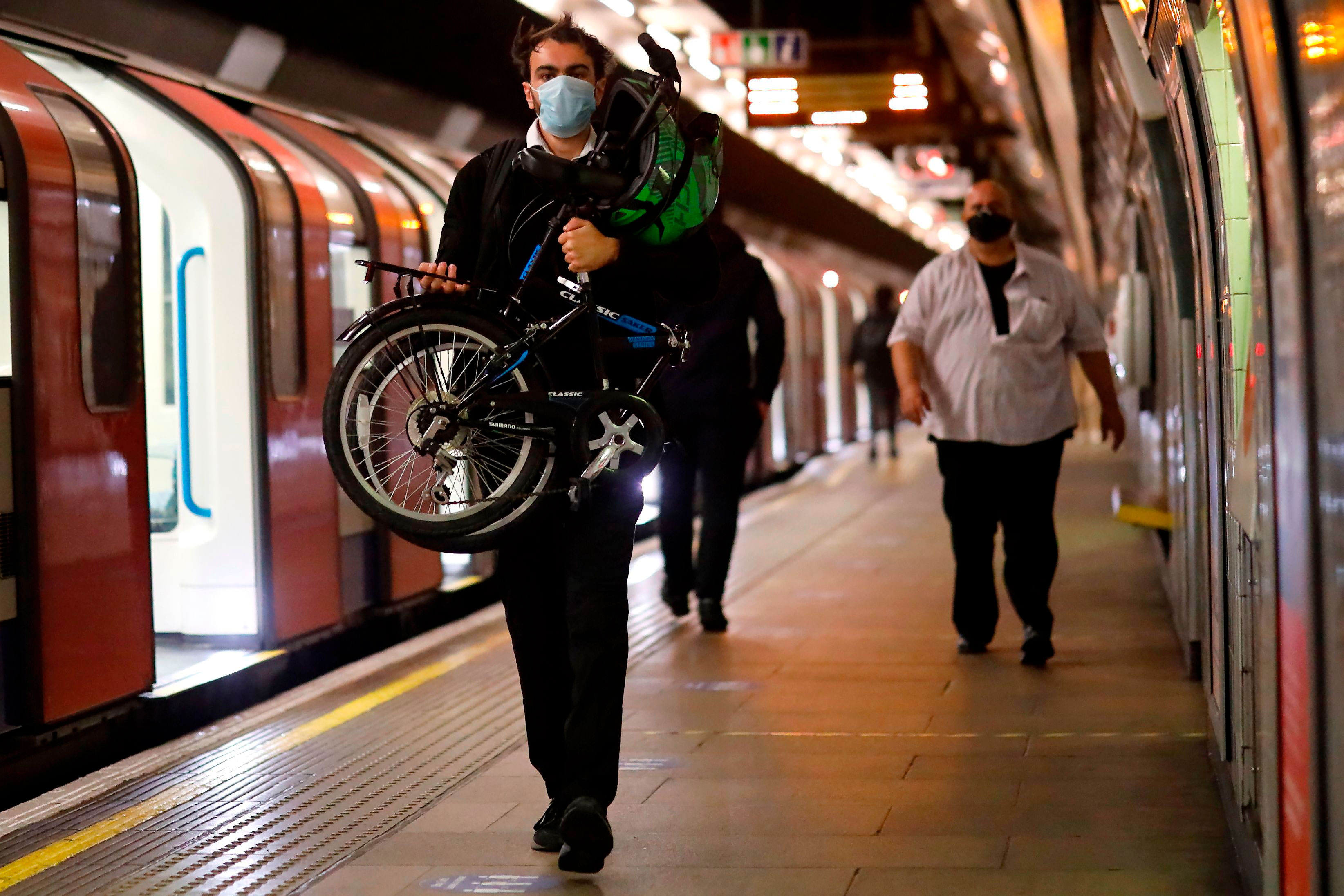 A commuter walks on the platform of a tube station in London on June5.