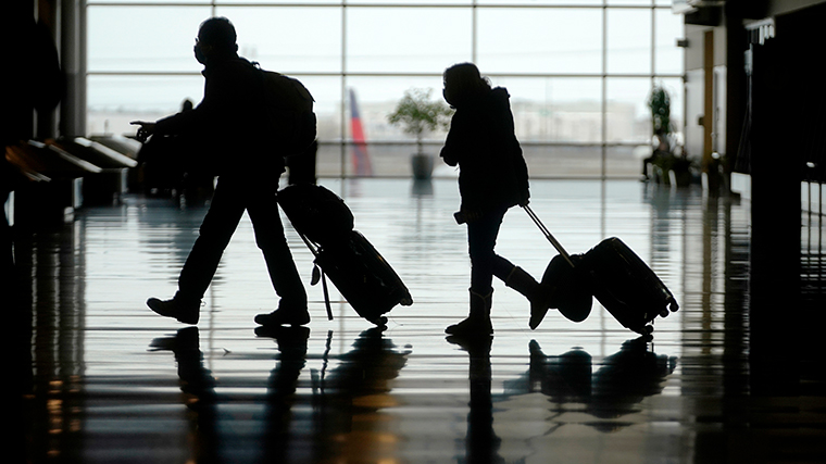 Travelers walk through in Salt Lake City International Airport, Tuesday, March 9, in Salt Lake City.