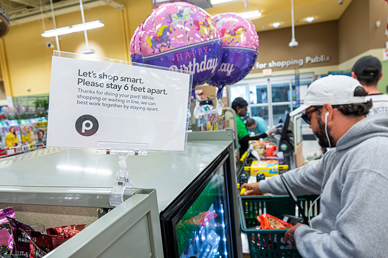 A customer checks out at a Publix store on April 1.