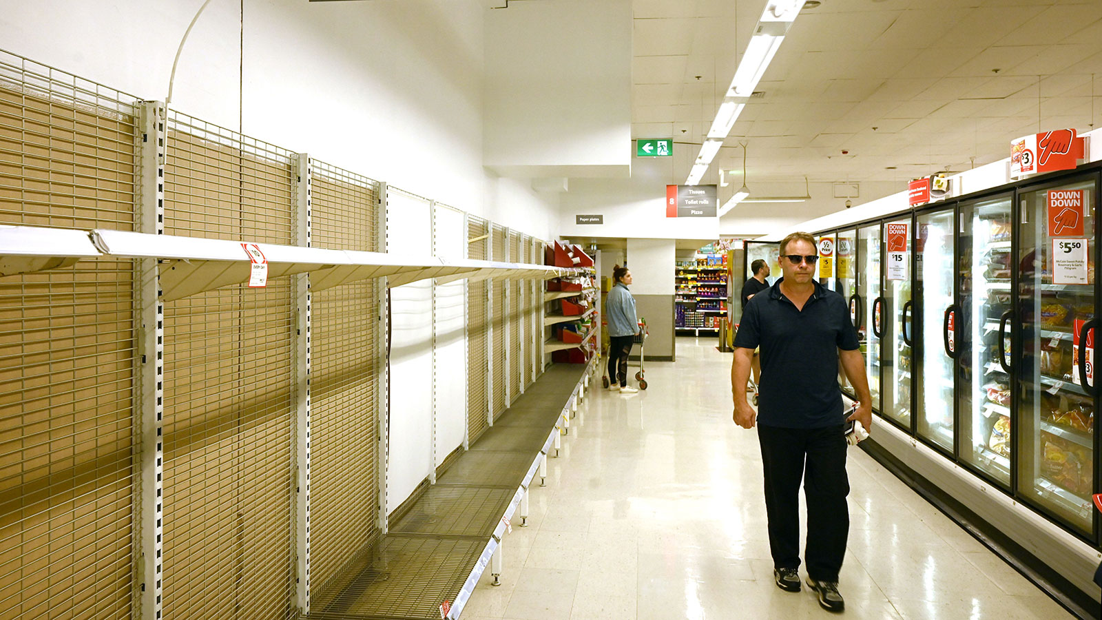 Shelves are empty of toilet rolls in a supermarket in Sydney on March 4.
