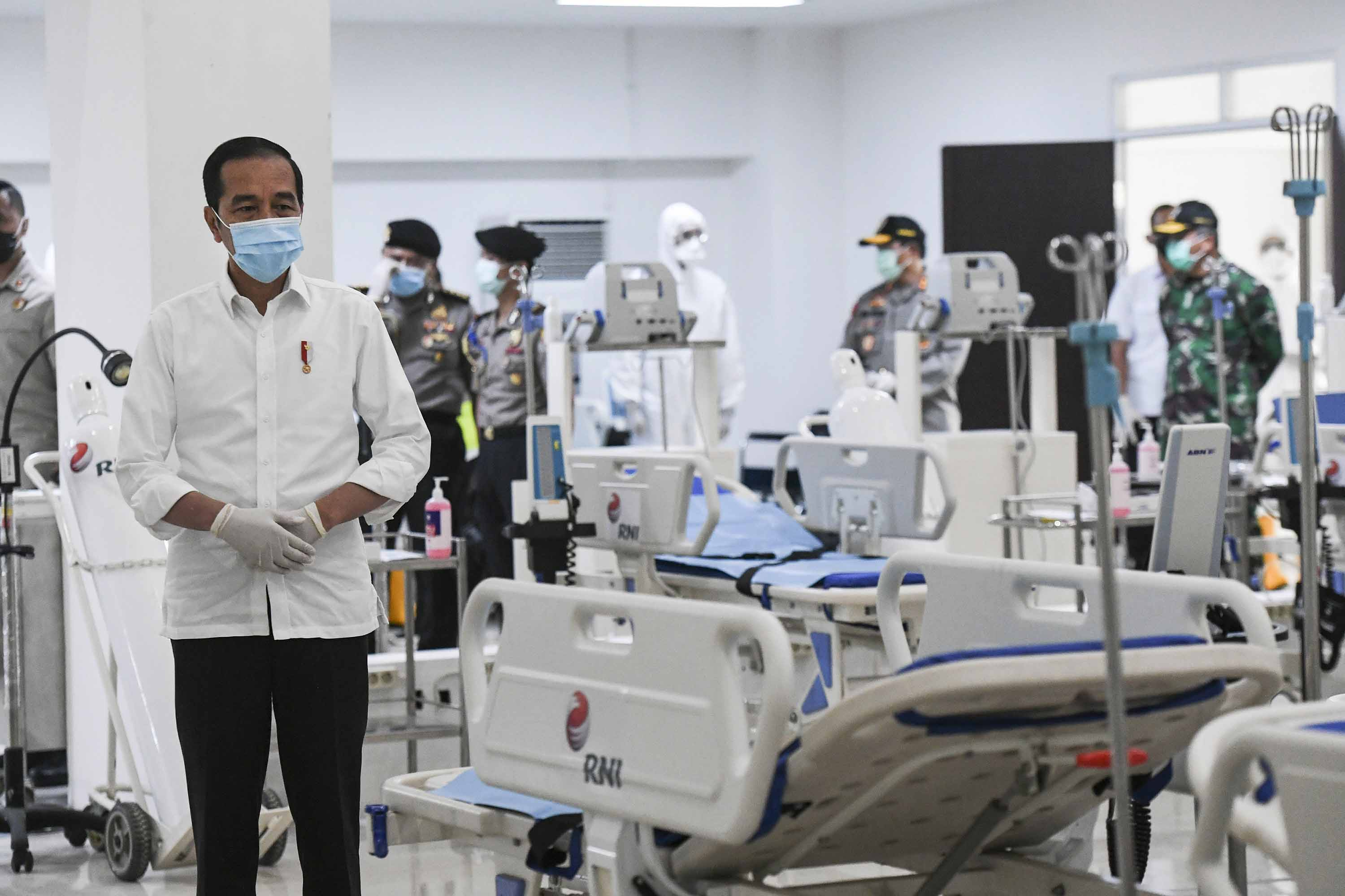 Indonesian President Joko Widodo, left, inspects medical equipment at a hospital in Jakarta, Indonesia, on March 23.