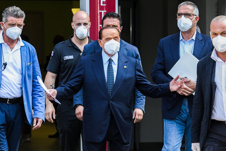 Former Italian prime minister Silvio Berlusconi, center, leaves the San Raffaele Hospital in Milan, Italy on September 14.