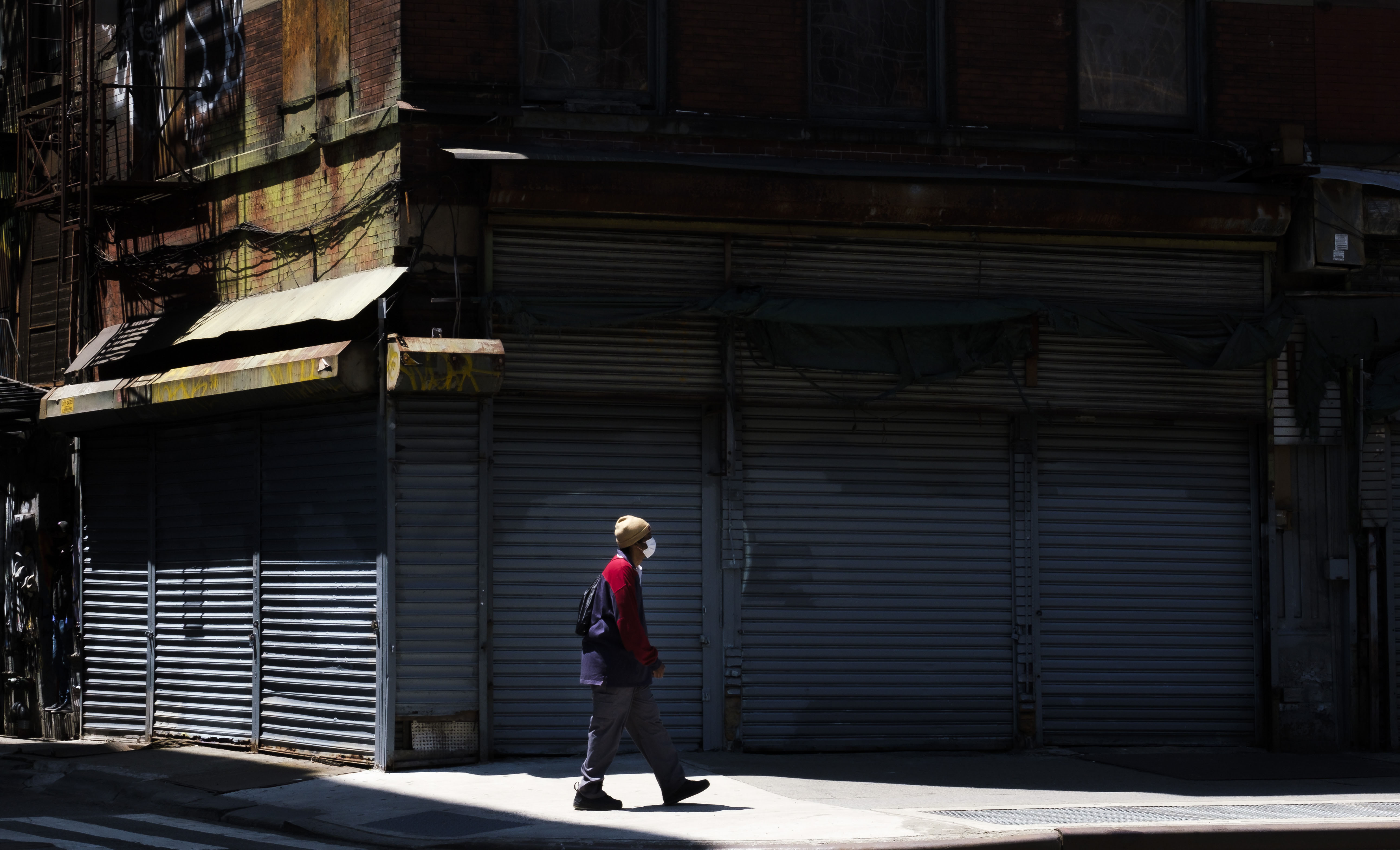 A person walks past closed businesses in New York on May 21.