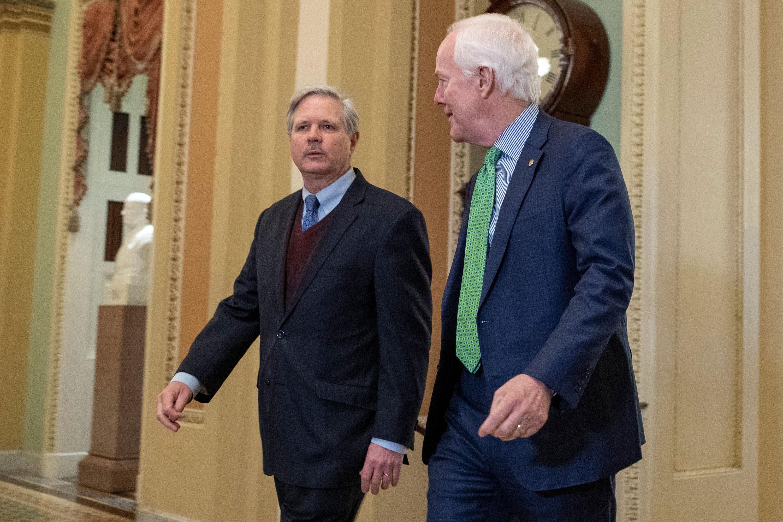 Sen. Hoeven, left, and Sen. John Cornyn walk to the Senate chamber on January 23.