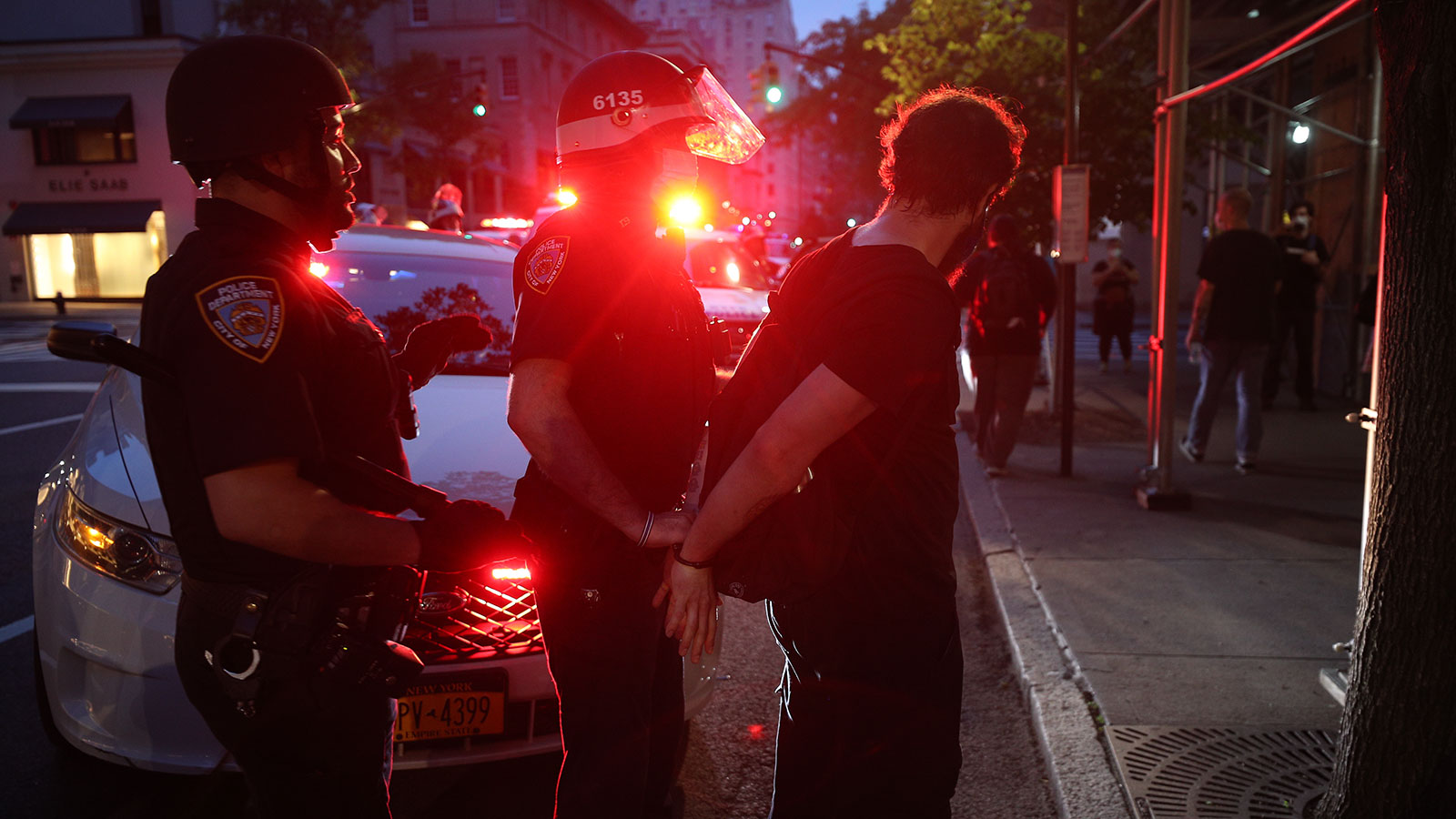 Police officers arrest protesters for breaking the curfew as they continued to protest demanding an end to police brutality and racial injustice over the death of George Floyd in New York City on June 4.