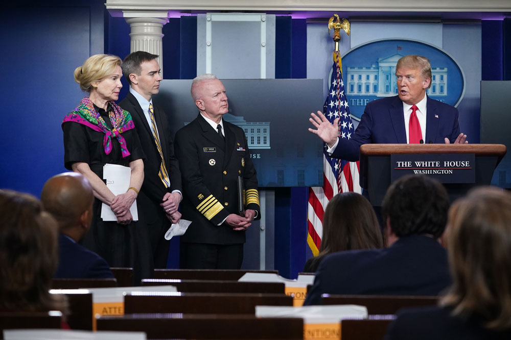 President Donald Trump answers questions from reporters during the daily briefing on the novel coronavirus at the White House in Washington on April 20.