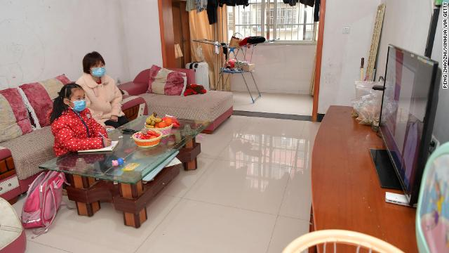 Gao Yingyan L, a student of No.4 Primary School in Wanli District, attends an online class at home in Nanchang City, east China's Jiangxi Province, February 10.