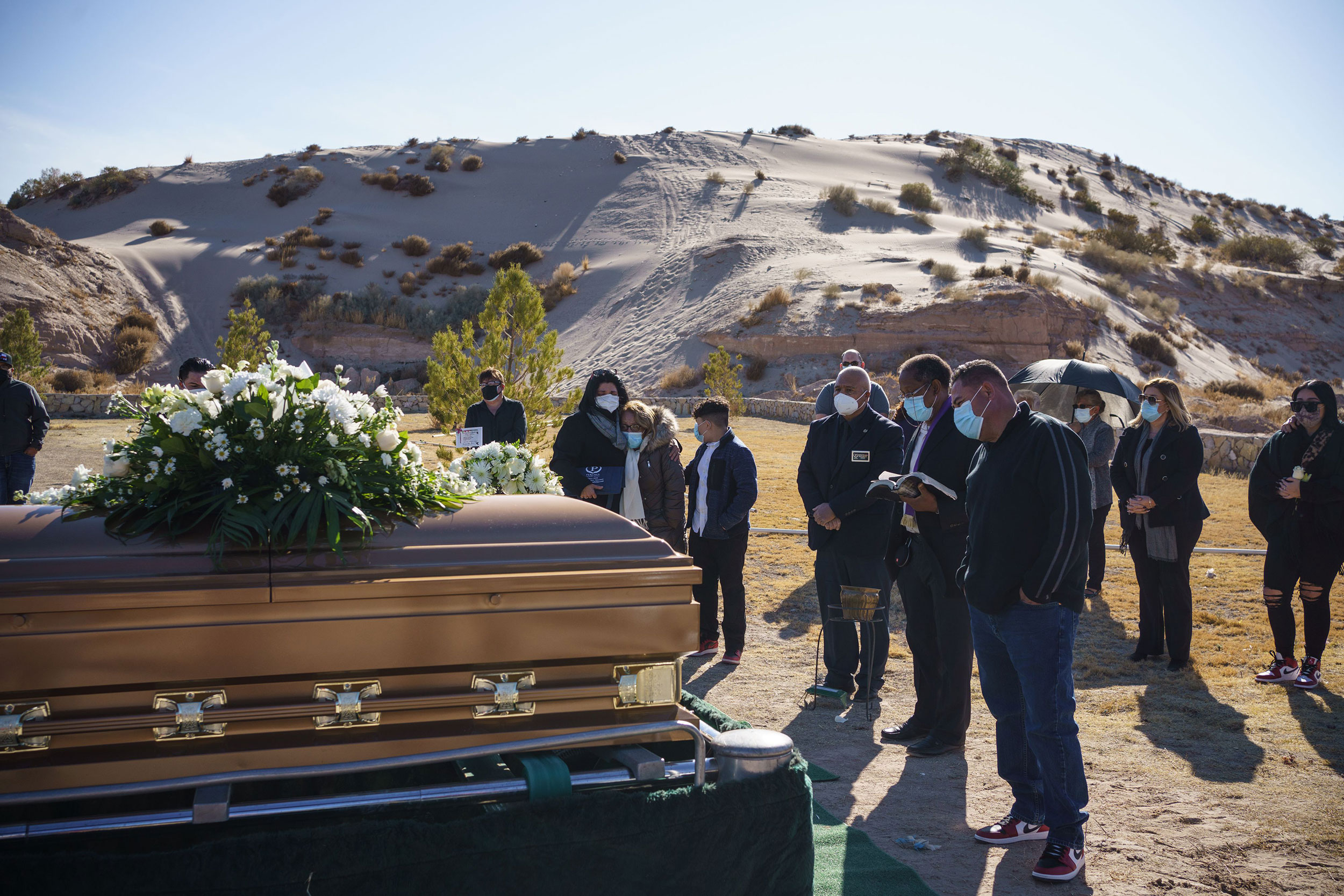 Family and friends attend the funeral of Humberto Rosales on December 3, in Santa Teresa, New Mexico. Rosales died from Covid-19 complications.