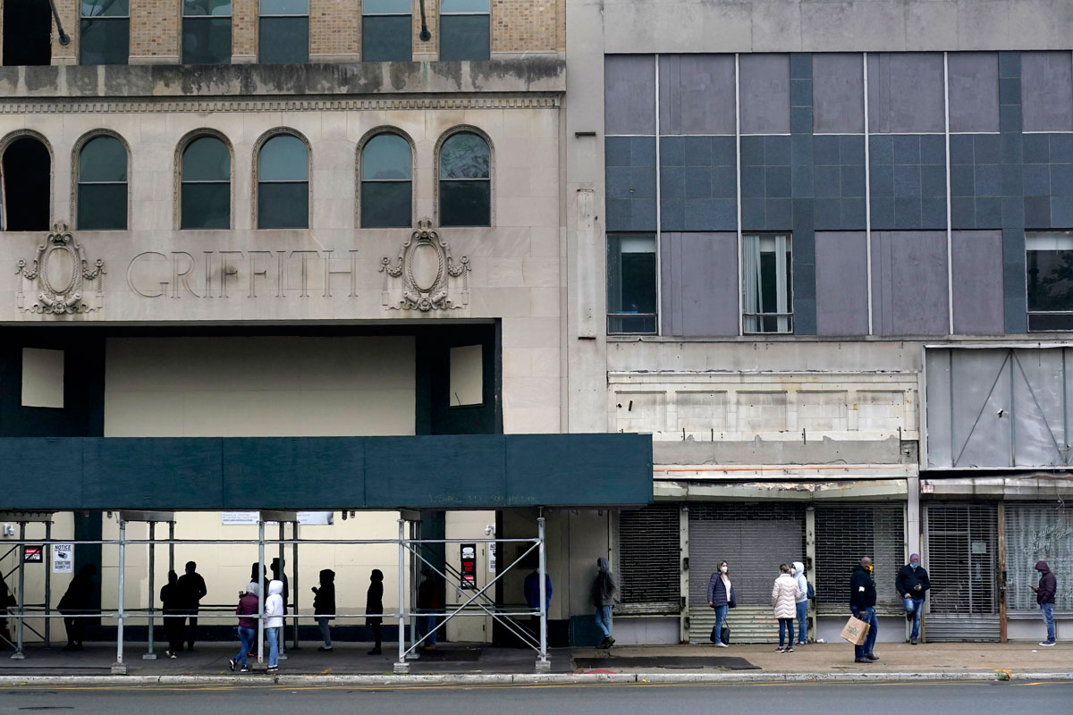 People wait in a line to get tested for COVID-19 at an urgent care clinic in Newark, New Jersey on October 26.