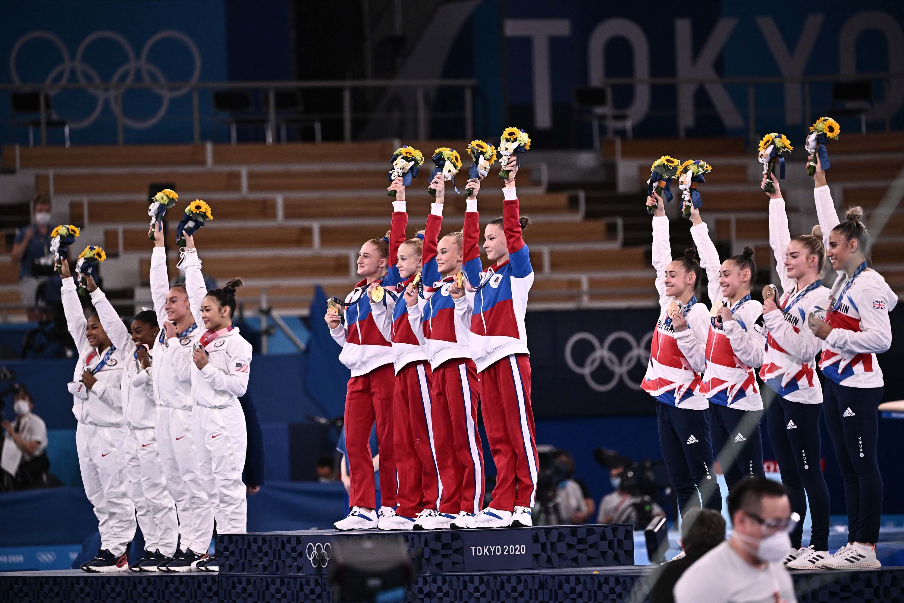 From left: Team USA (silver), Team ROC (gold) and Team Great Britain (bronze) pose during the podium ceremony of the artistic gymnastics women's team final on July 27.