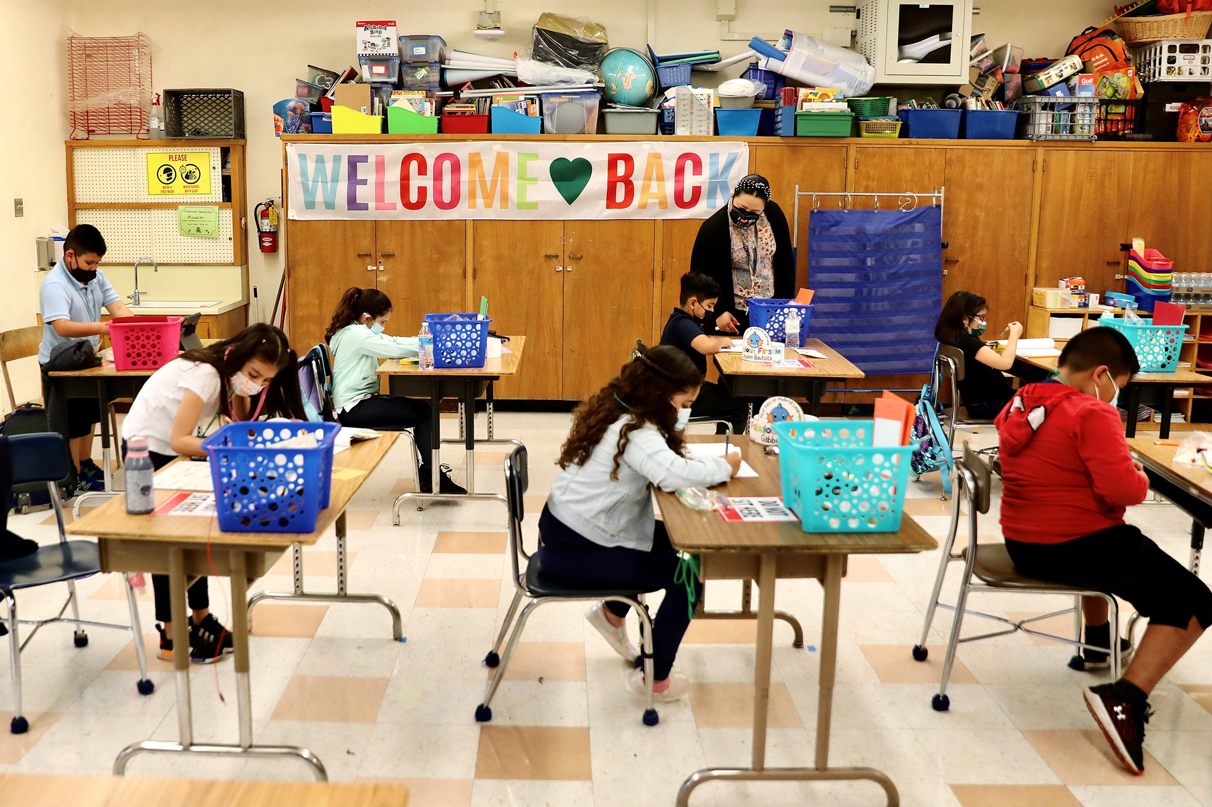 Students attend in-person class at a school in Los Angeles, California, on April 13.