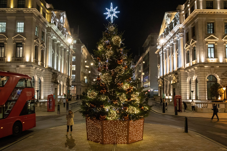 A Christmas tree illuminates a street in London on November 19.
