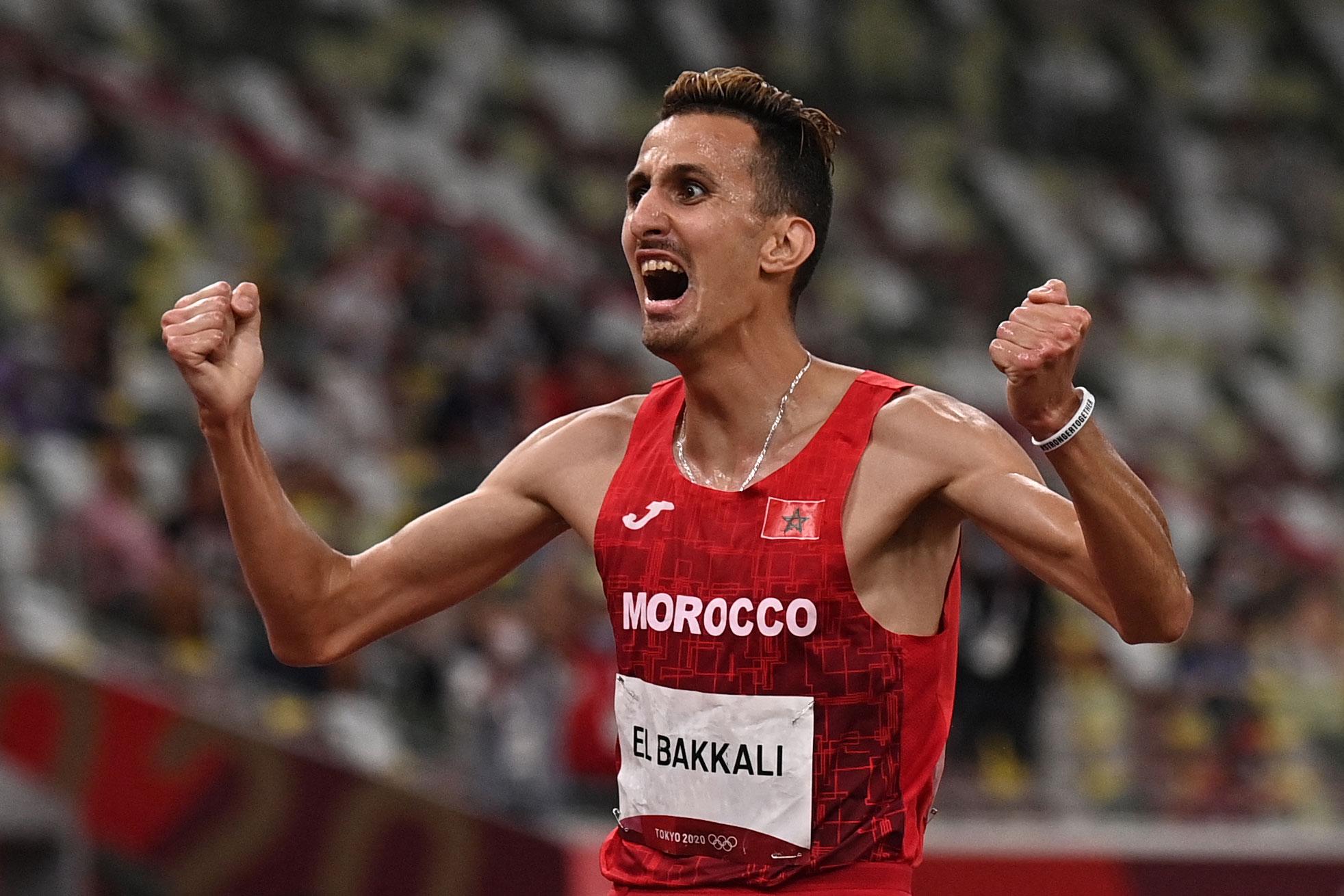 Morocco's Soufiane El Bakkali celebrates winning gold in the 3000-meter steeplechase on August 2.