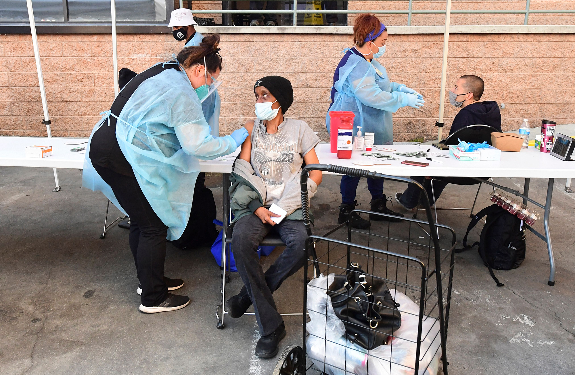 Registered nurses administer the Moderna Covid-19 vaccine to eligible people identified by homeless service agencies from the parking lot of the L.A. Mission on February 24, in Los Angeles.