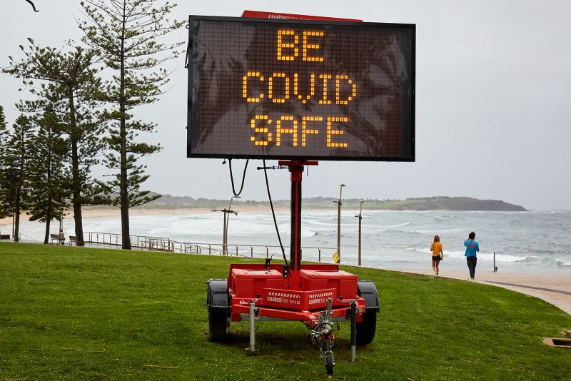 A Covid-19 digital sign is seen on Dee Why beachfront on December 19, in Sydney, Australia.