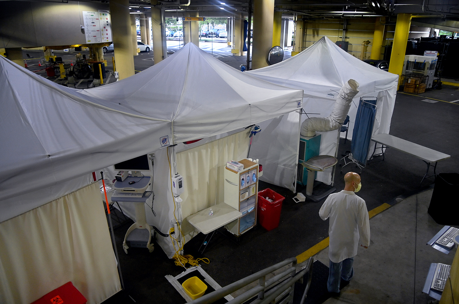 Dr. Davis Wein, an emergency medicine specialist walks, in the parking garage that was turned into a series of Covid-19 test tents at Tampa General Hospital in Florida on August 19.