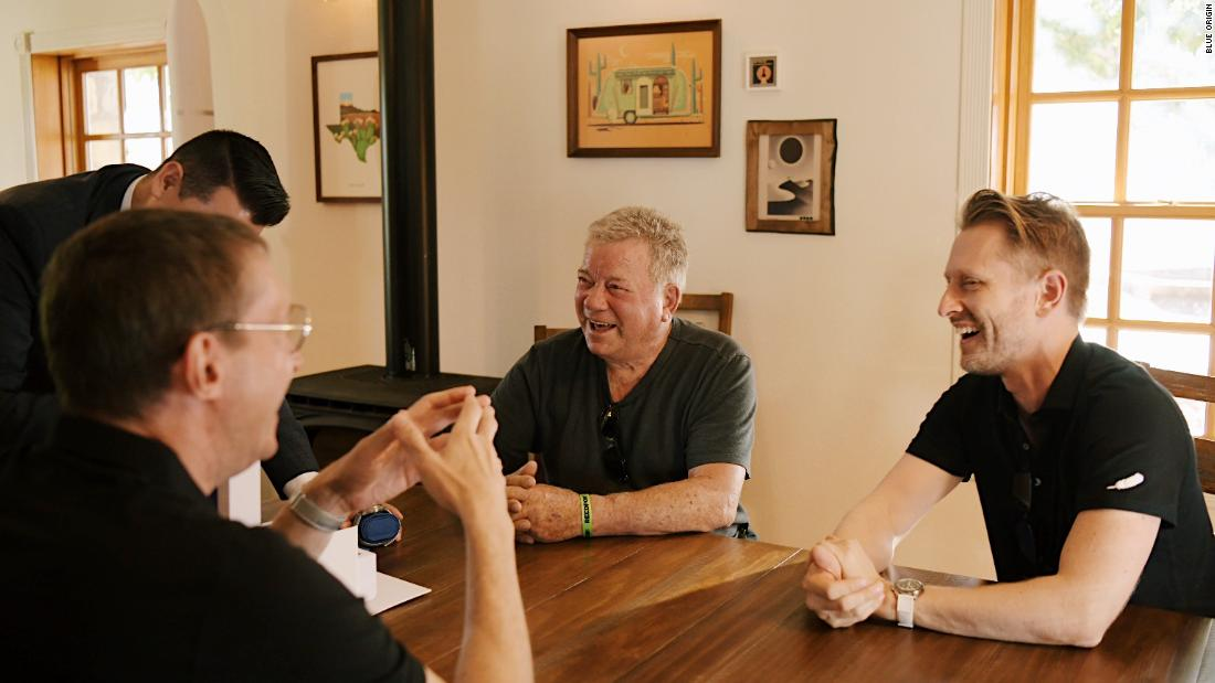 William Shatner chats with fellow NS-18 crew members Chris Boshuizen (right) and Glen de Vries (across) on October 9.