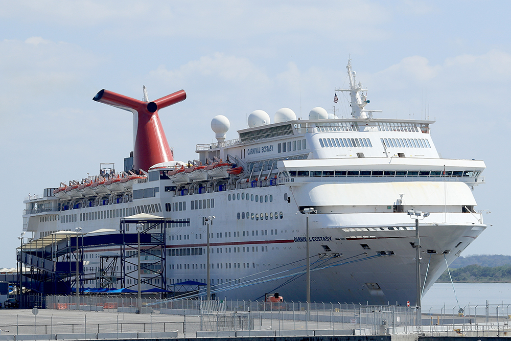 Carnival Cruise Line's Carnival Ecstasy cruise ship is docked at the Port of Jacksonville amid the Coronavirus outbreak on March 27 in Jacksonville, Florida.