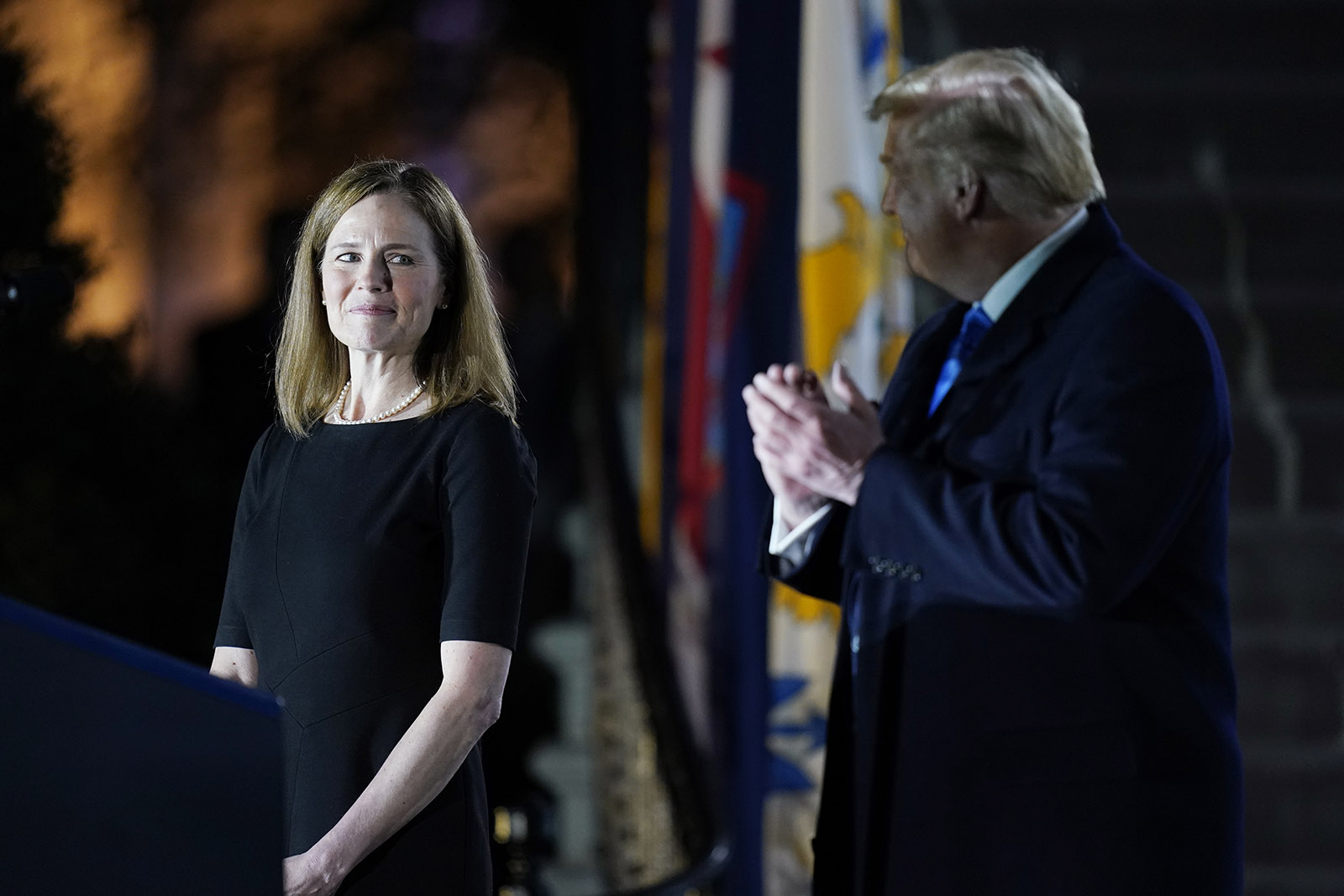 President Donald Trump looks toward Amy Coney Barrett, before Supreme Court Justice Clarence Thomas administers the Constitutional Oath to her on the South Lawn of the White House in Washington, on Monday.