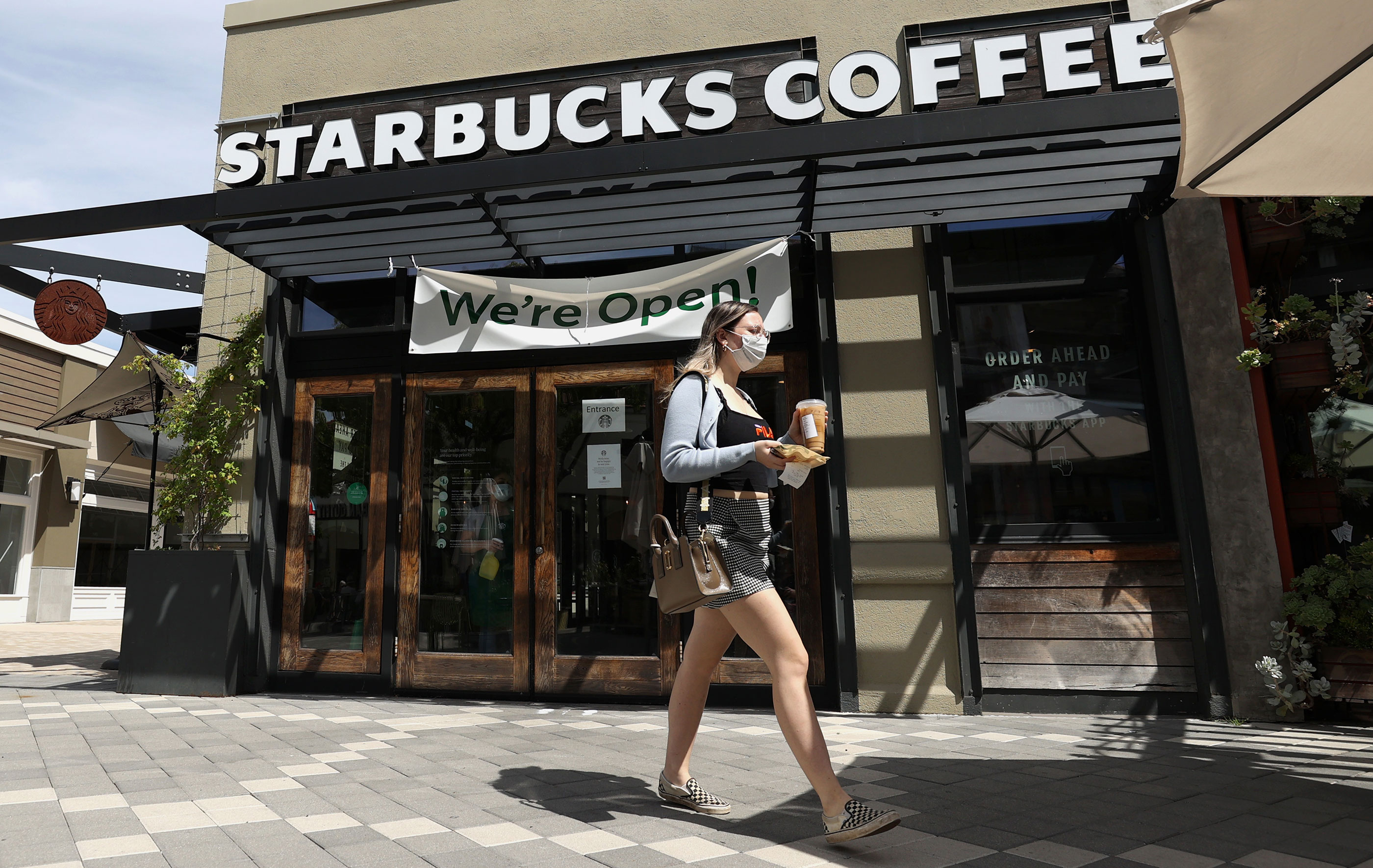 A customer walks by a Starbucks Coffee store on June 10 in Corte Madera, California.